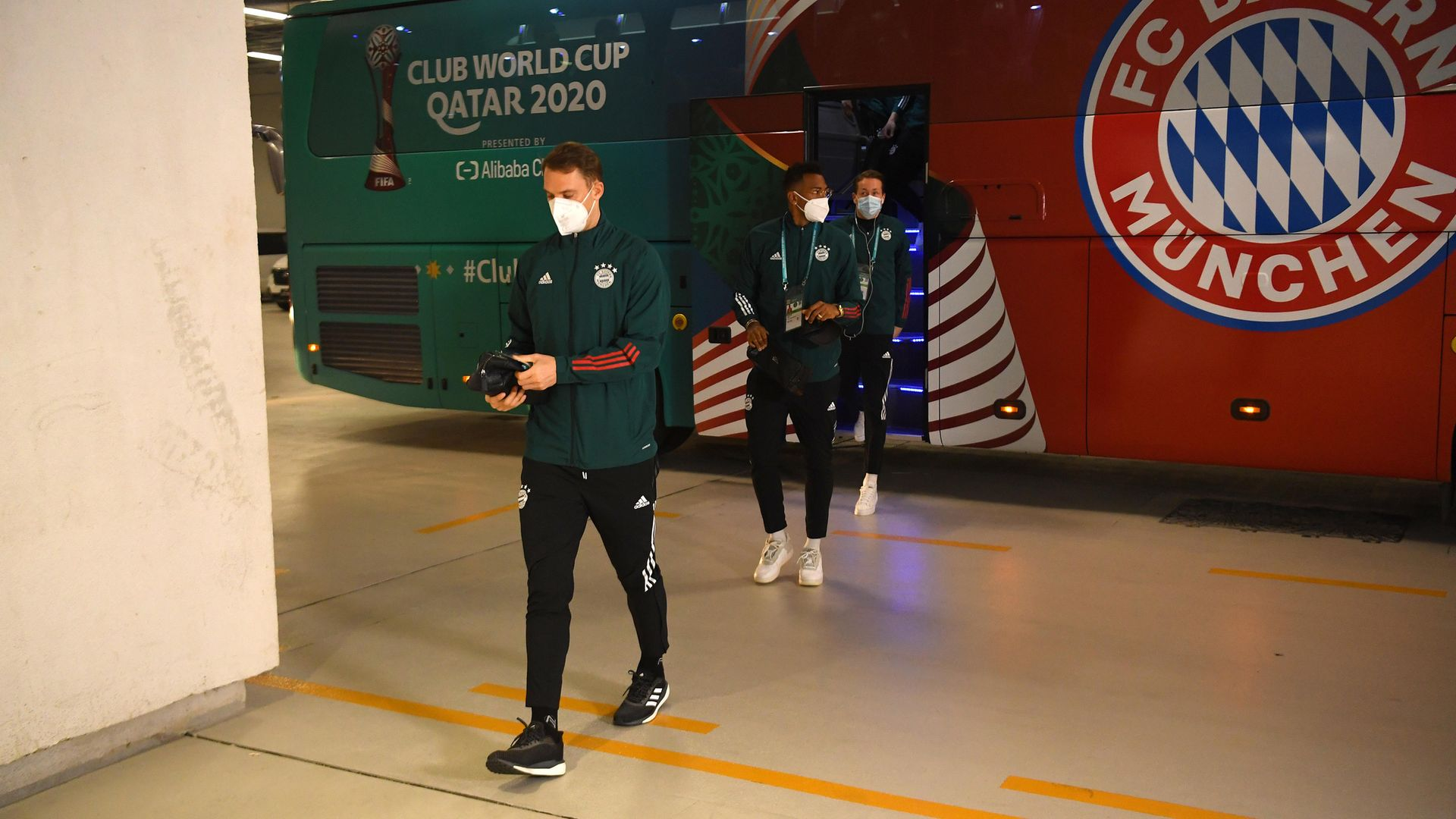 Back on track: Manuel Neuer and Jerome Boateng of Bayern Munich arrive at the stadium prior to the match against Al Ahly at the Ahmad Bin Ali Stadium in Doha, Qatar - Credit: FIFA via Getty Images