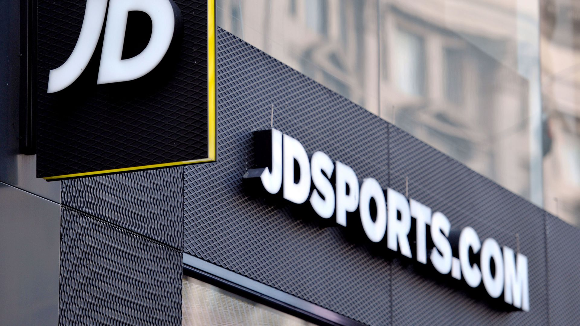 A shop sign for JD Sports in central London - Credit: PA