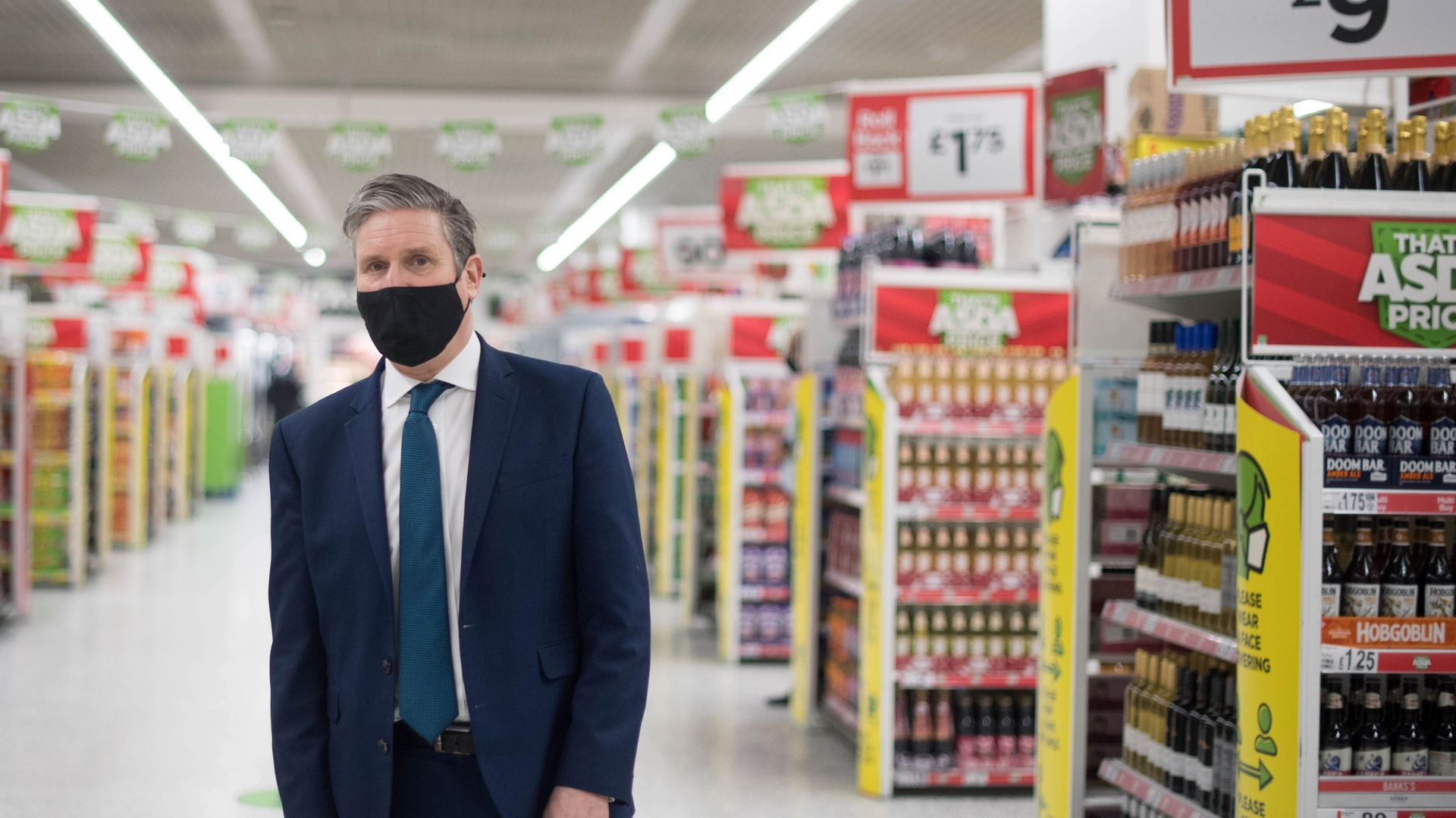 CHECKING OUT?: Keir Starmer during a visit to a community pharmacy vaccination centre set up inside an ASDA supermarket in Watford - Credit: POOL/AFP via Getty Images