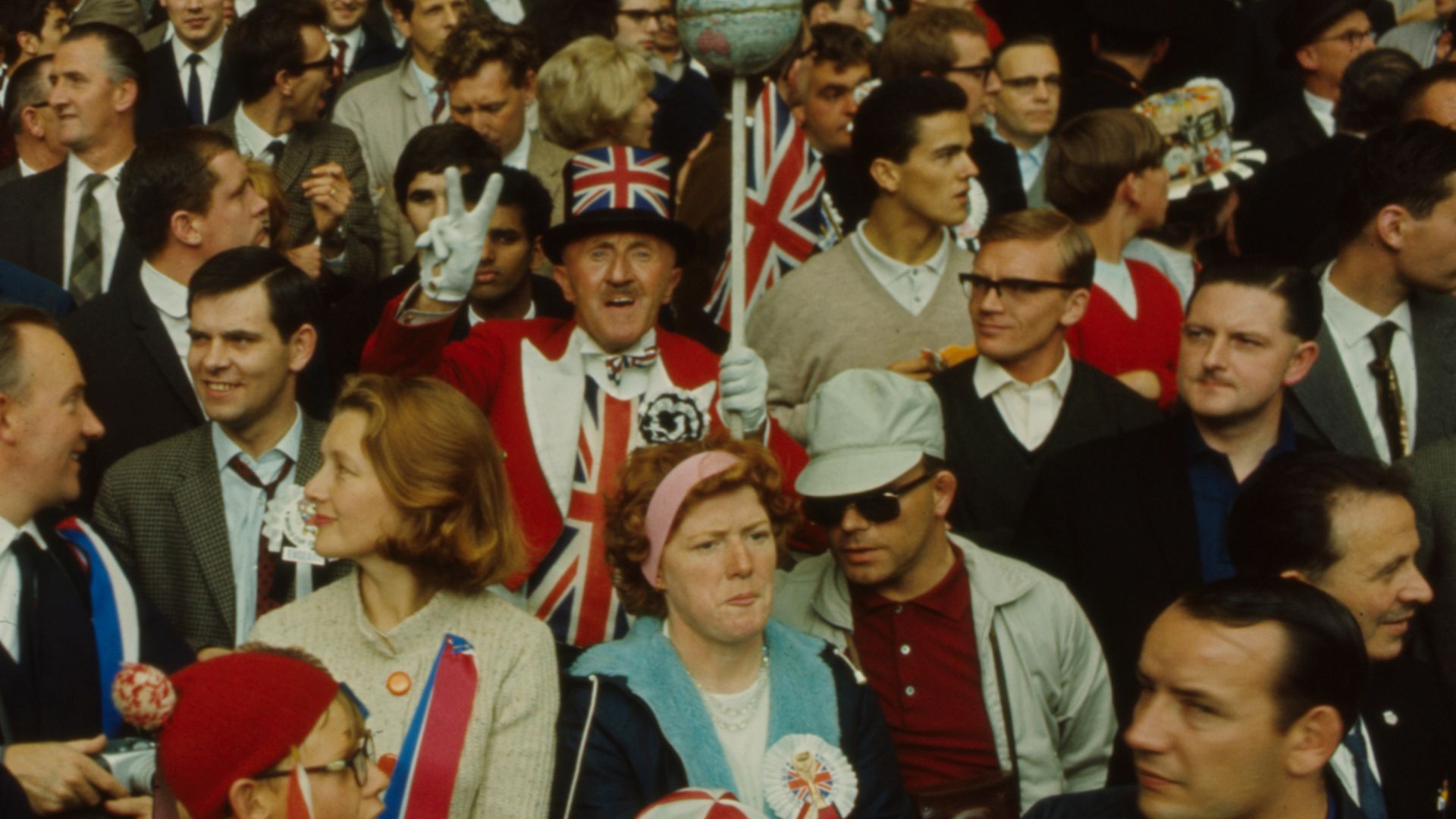 UNITED CHAMPIONS: Union flags aplenty amid England fans at Wembley during the 1966 World Cup - Credit: Getty Images