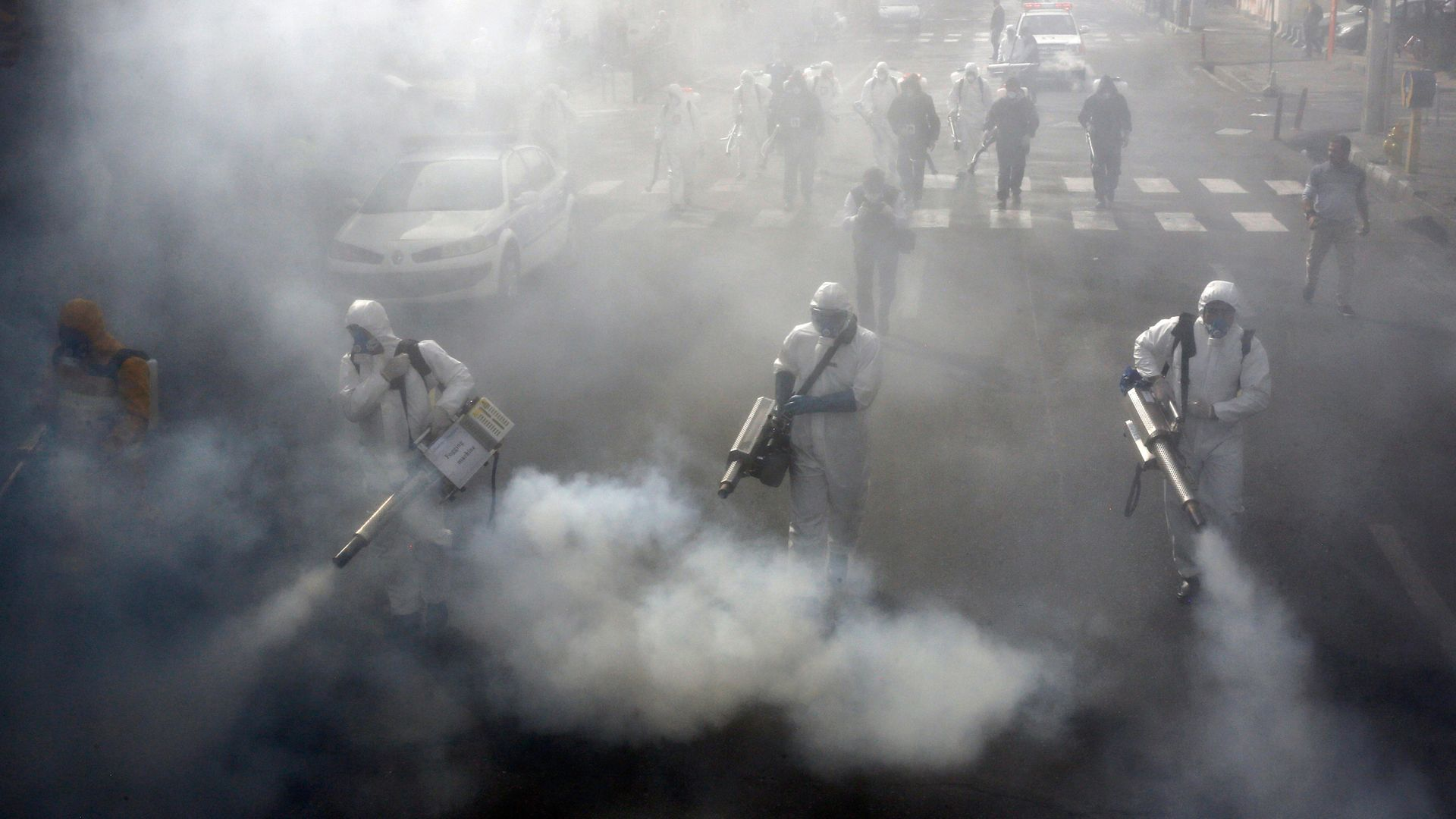 Iranian Firefighters disinfect streets in Tehran in a bid to halt the spread of coronavirus in March 2020 - Credit: AFP via Getty Images