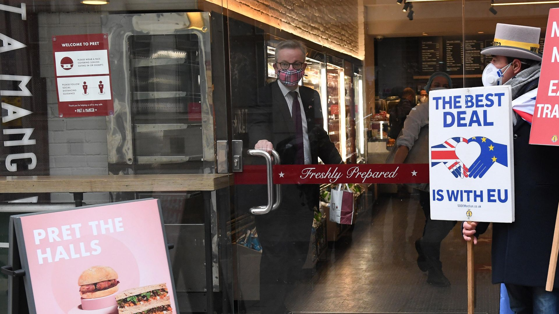 The Chancellor of the Duchy of Lancaster, Michael Gove, collects his morning coffee from a coffee shop in central London - Credit: PA