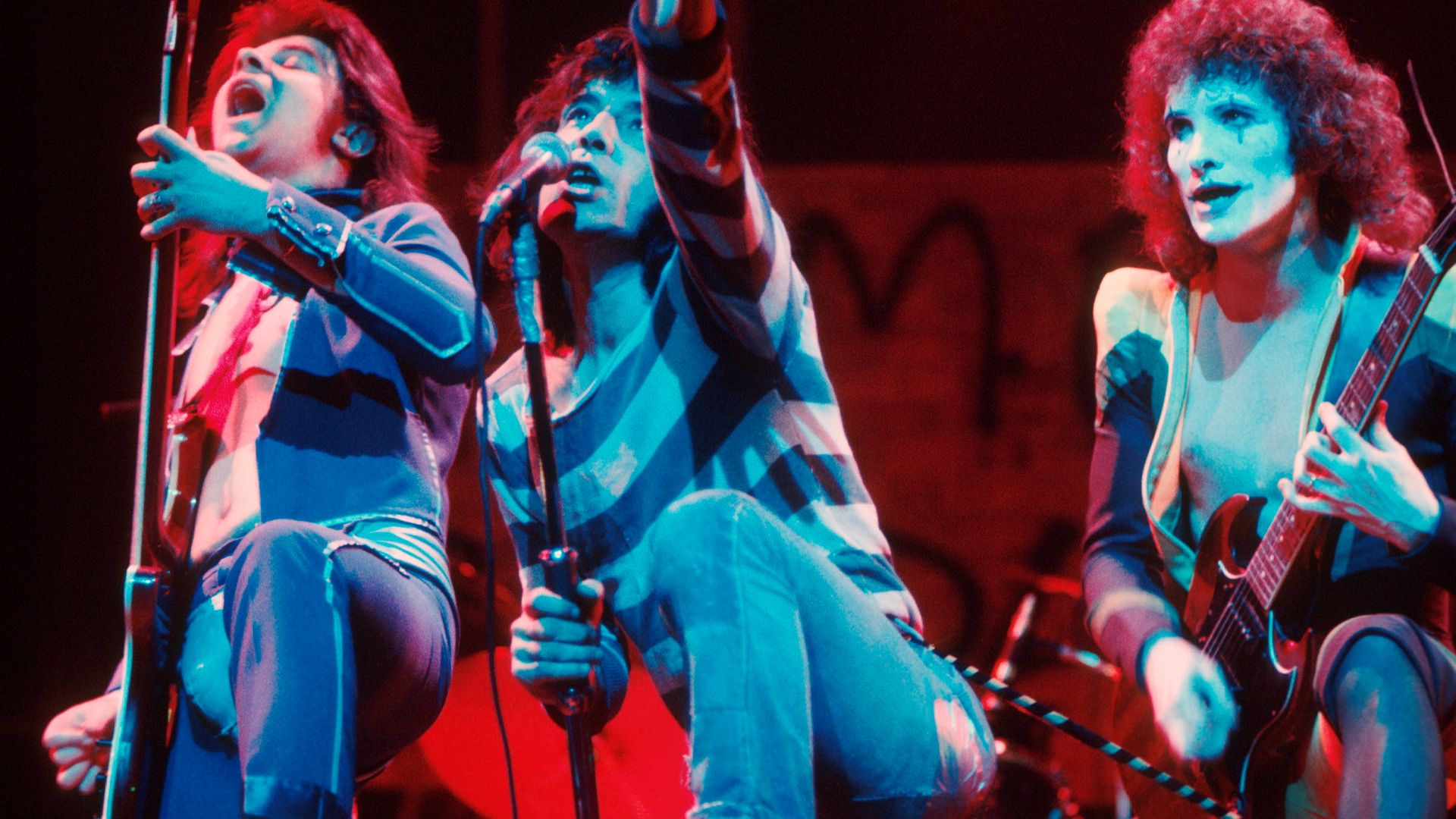 The Sensational Alex Harvey Band perform on stage in 1975. From left to right: Chris Glen, Alex Harvey, Zal Cleminson - Credit: Getty Images