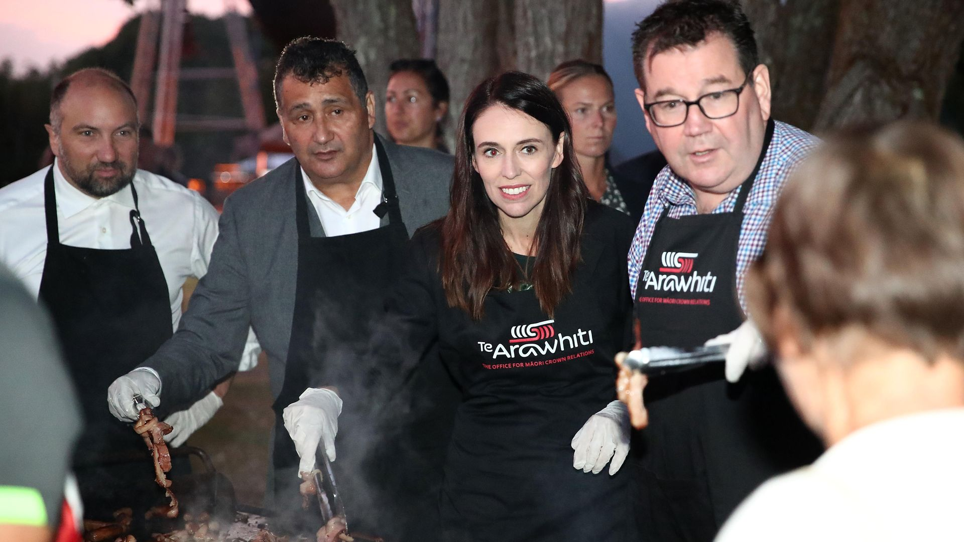 Prime minister Jacinda Ardern and finance minister Grant Robertson cook breakfast for crowds after a dawn service on the Waitangi Day national holiday - Credit: Getty Images