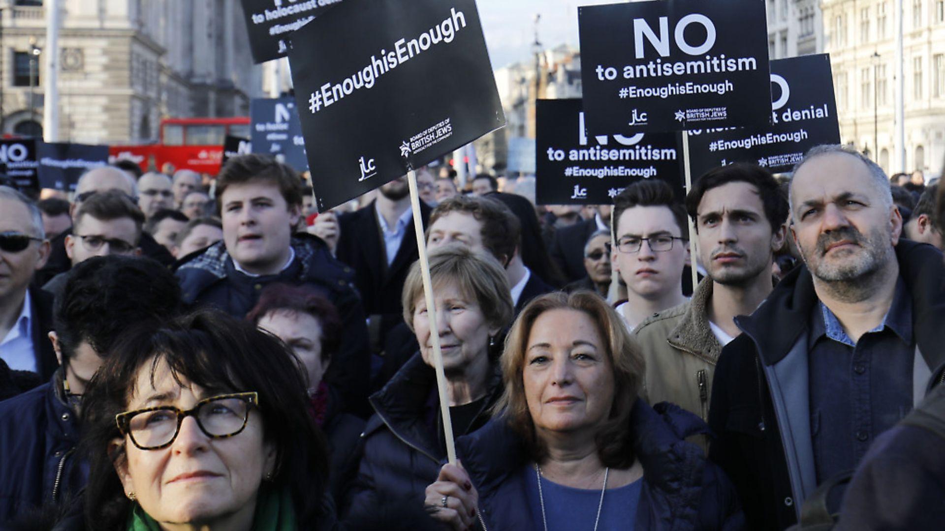 Members of the Jewish community hold a protest against anti-semitism. Photo: TOLGA AKMEN/AFP via Getty Images - Credit: AFP via Getty Images