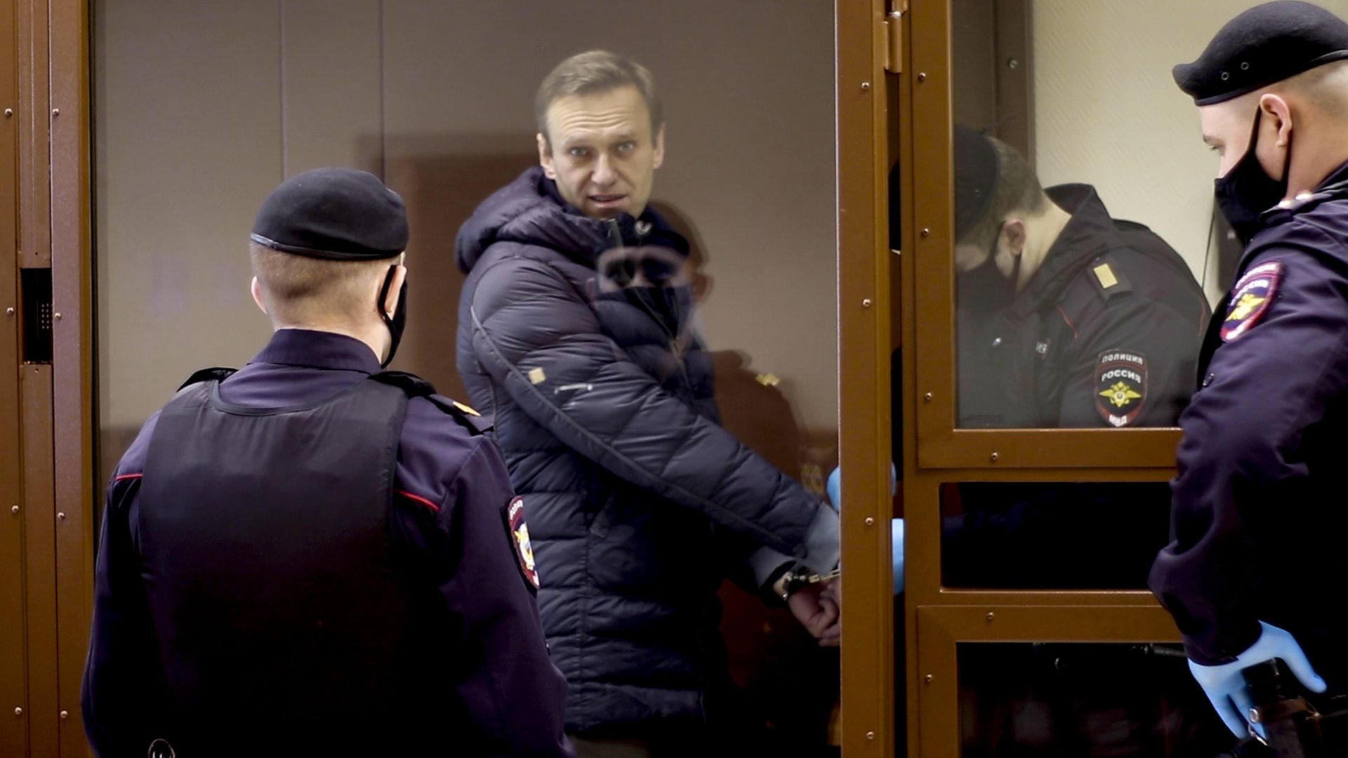 TRAPPED: Russian opposition Alexei Navalny appears in court in Moscow - Credit: Anadolu Agency via Getty Images