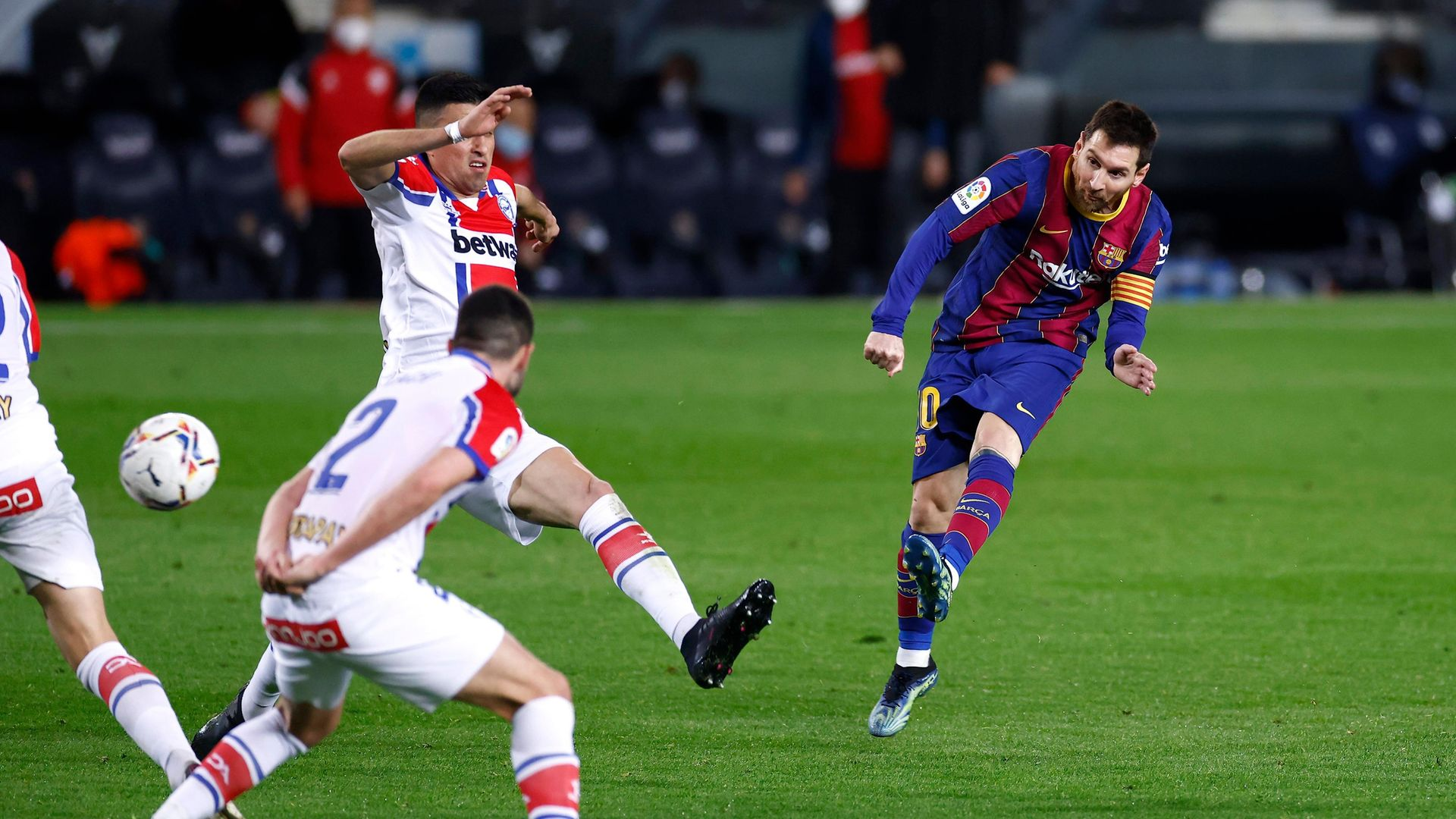 Lionel Messi of FC Barcelona scores at Camp Nou (Photo by Eric Alonso/Getty Images) - Credit: Getty Images