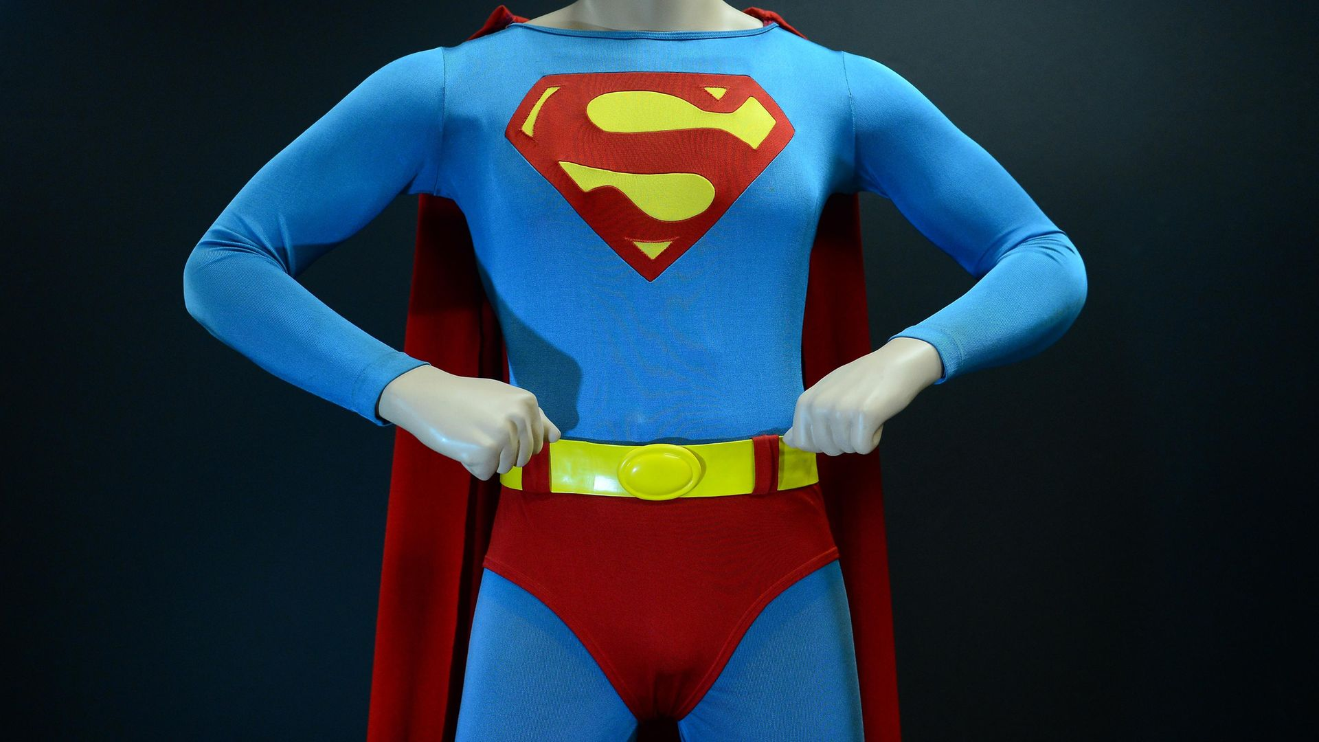 The Superman costume that was worn by Christopher Reeve in Superman: The Movie - Credit: AFP via Getty Images