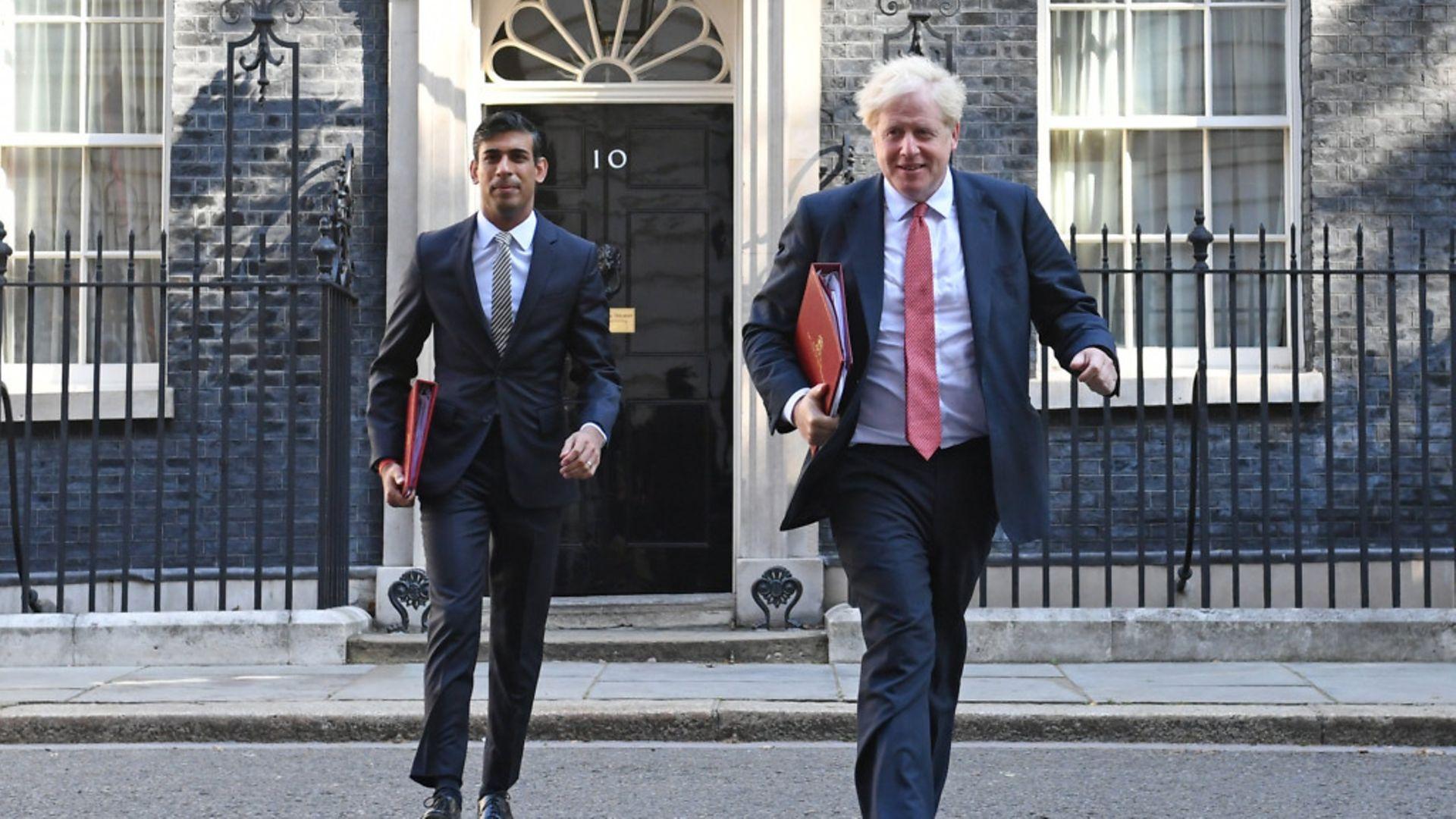 Chancellor Rishi Sunak (L) and prime minister Boris Johnson leave 10 Downing Street - Credit: Stefan Rousseau/PA