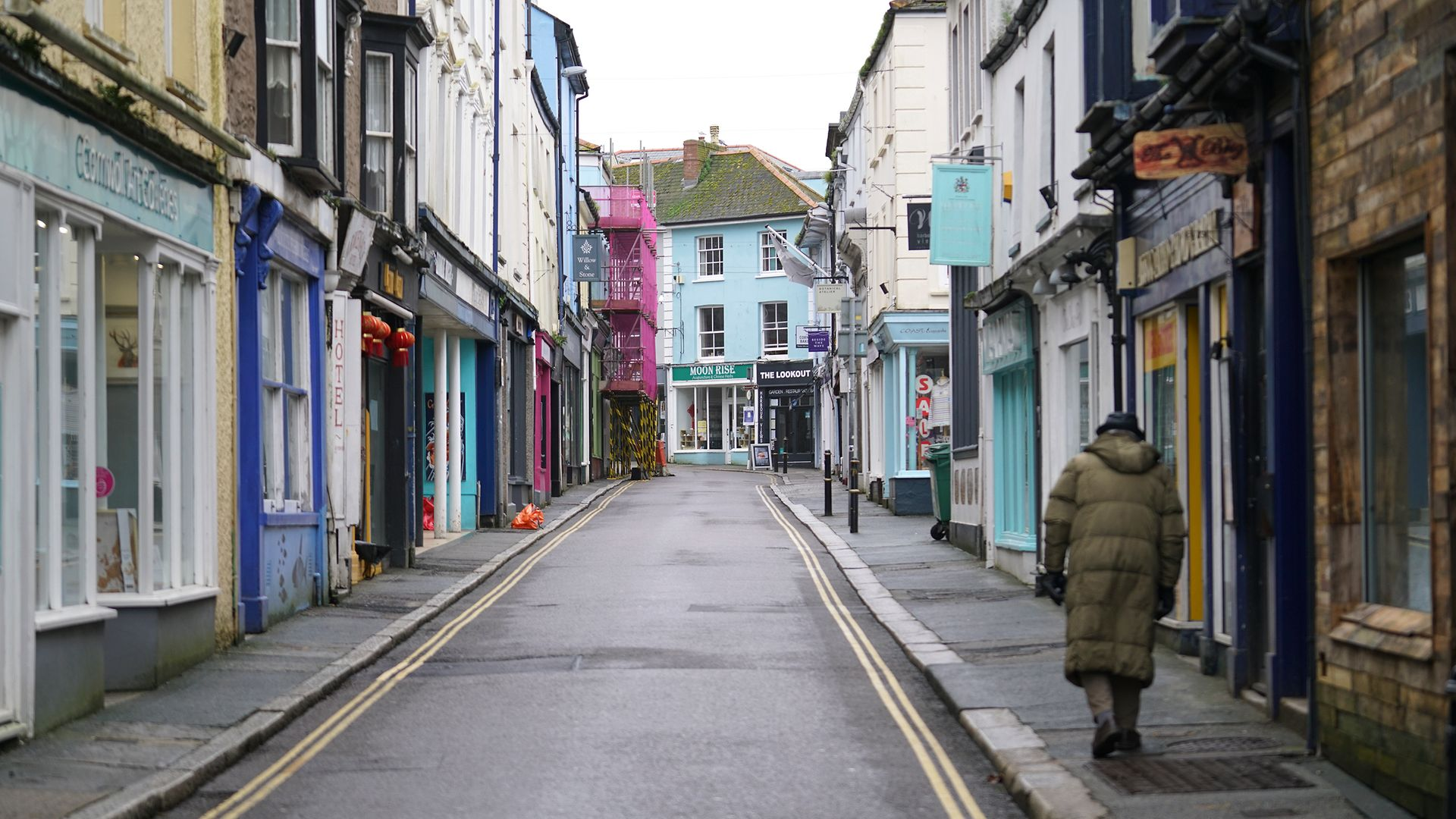 A lone person in roads that would normally be packed with visitors during half-term week in Falmouth - Credit: Getty Images