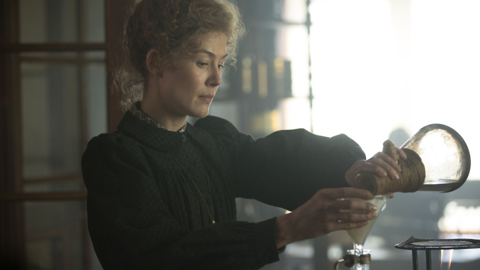 Rosamund Pike as Marie Curie in Radioactive. Photograph: Studio Canal. - Credit: Archant