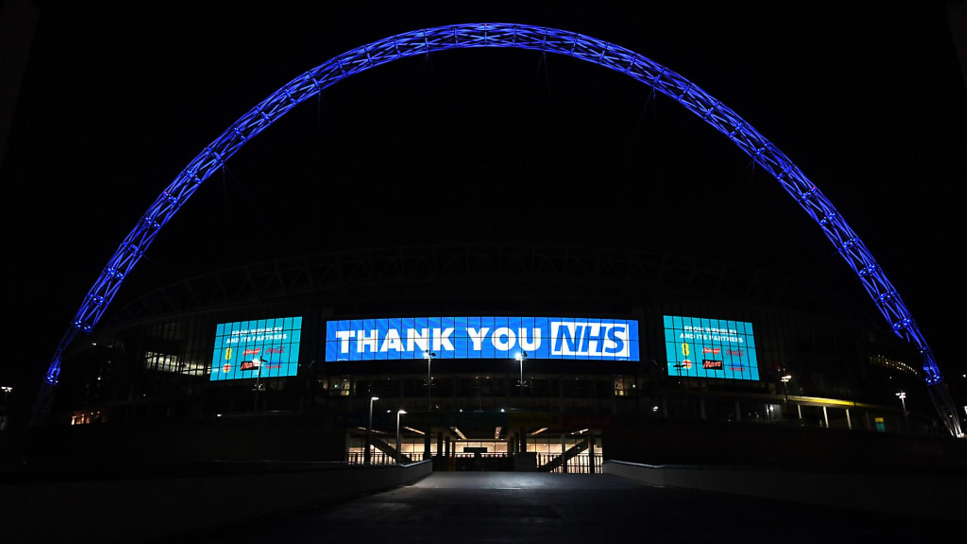 Wembley Arch is illuminated in blue to show its appreciation to the NHS amid the coronavirus outbreak in London. Photograph: Kirsty O' Connor/PA Wire. - Credit: PA