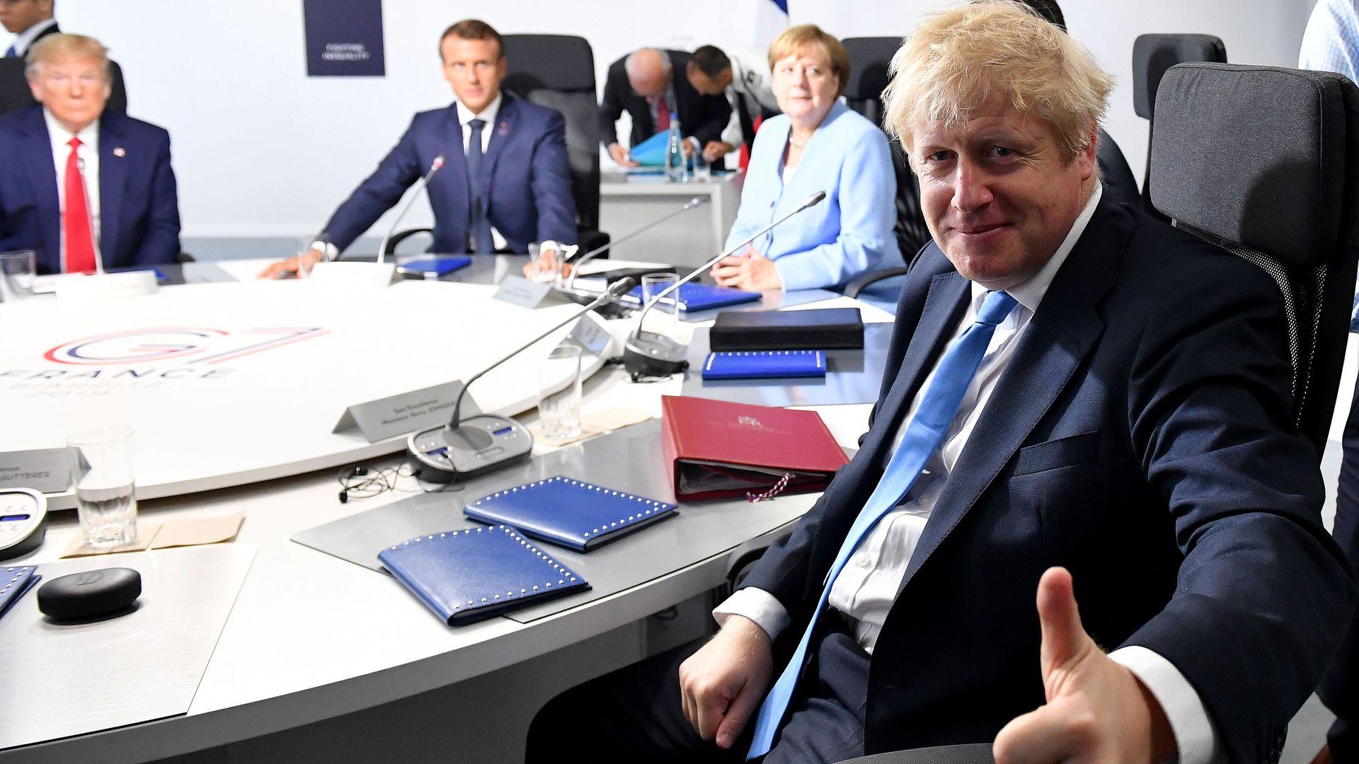 Boris Johnson at a meeting of the G7 alongside Angela Merkel, Emmanuel Macron and Donald Trump - Credit: PA
