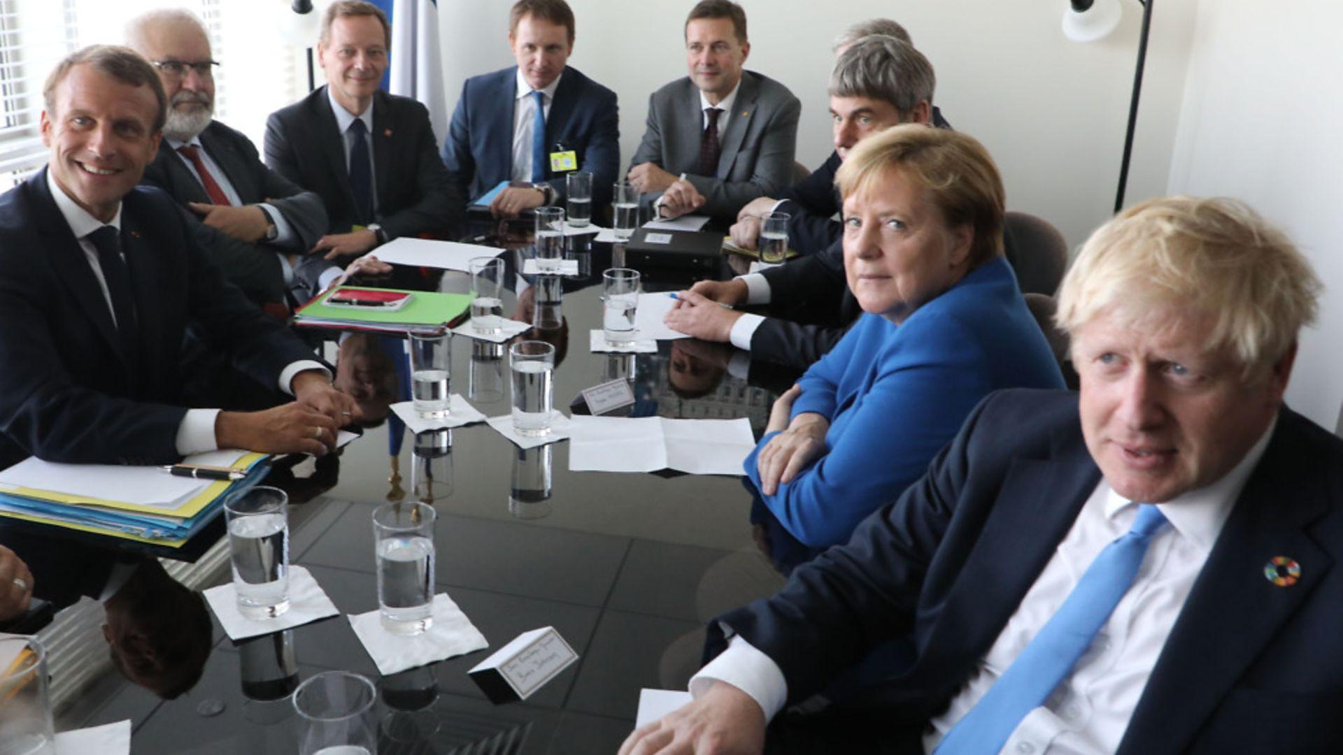 Boris Johnson with world leaders including Angela Merkel and Emmanuel Macron - Credit: AFP via Getty Images
