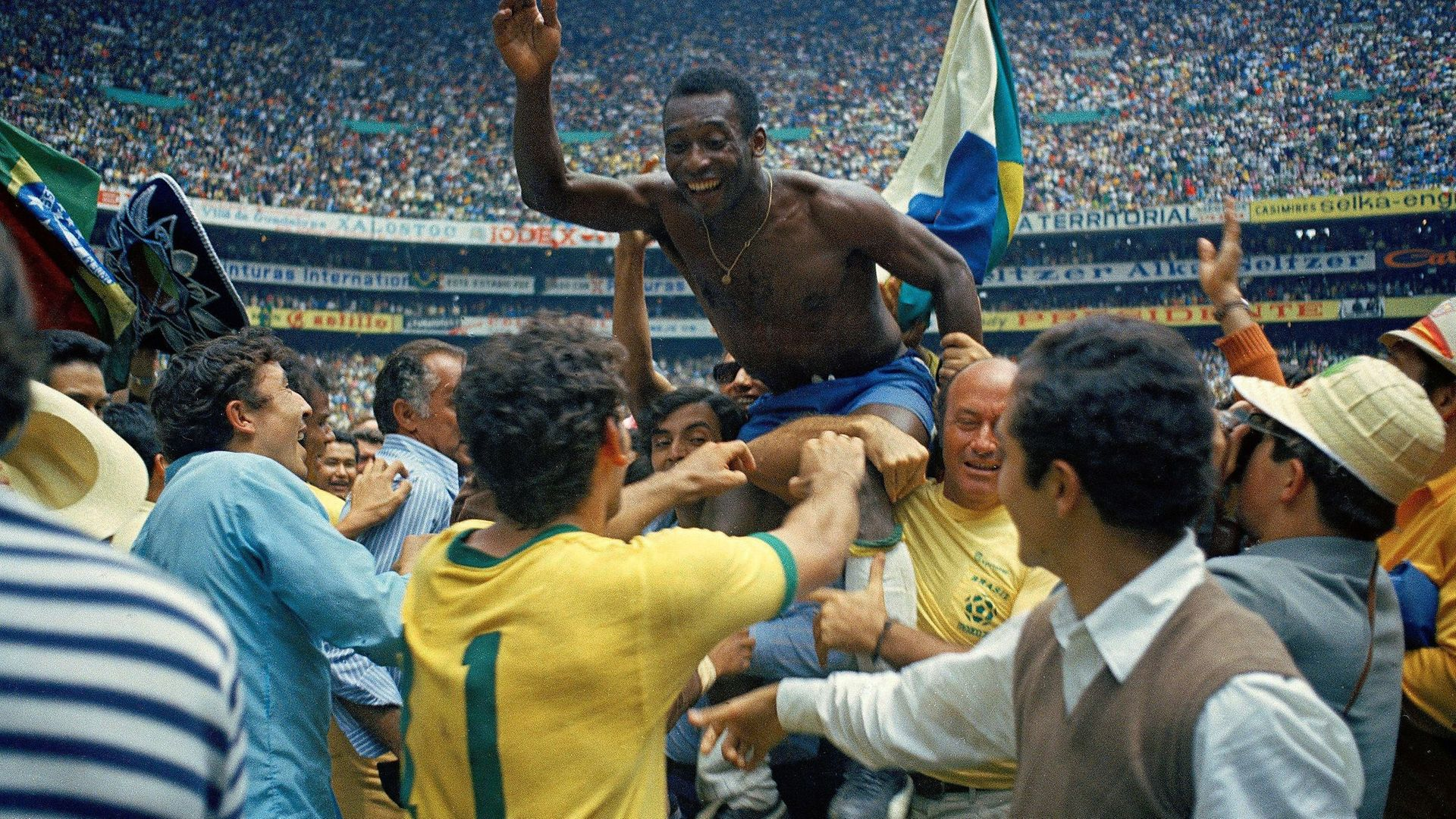 Pele is held aloft after Brazil beat Italy 4-1 to win the World Cup final on June 21st 1970. - Credit: Getty Images