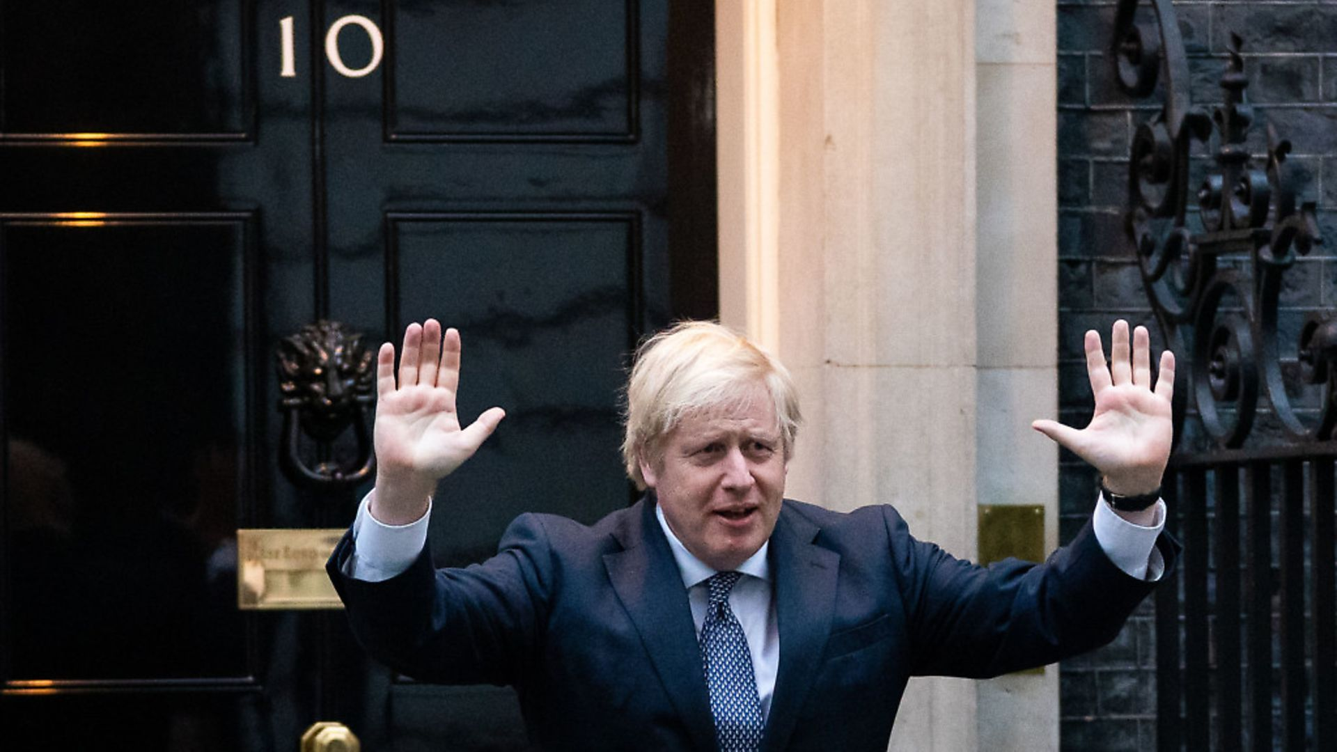Prime Minister Boris Johnson stands outside 10 Downing Street as he joins in the applause to salute local heroes during Thursday's nationwide Clap for Carers. Photograph: Aaron Chown/PA Wire. - Credit: PA