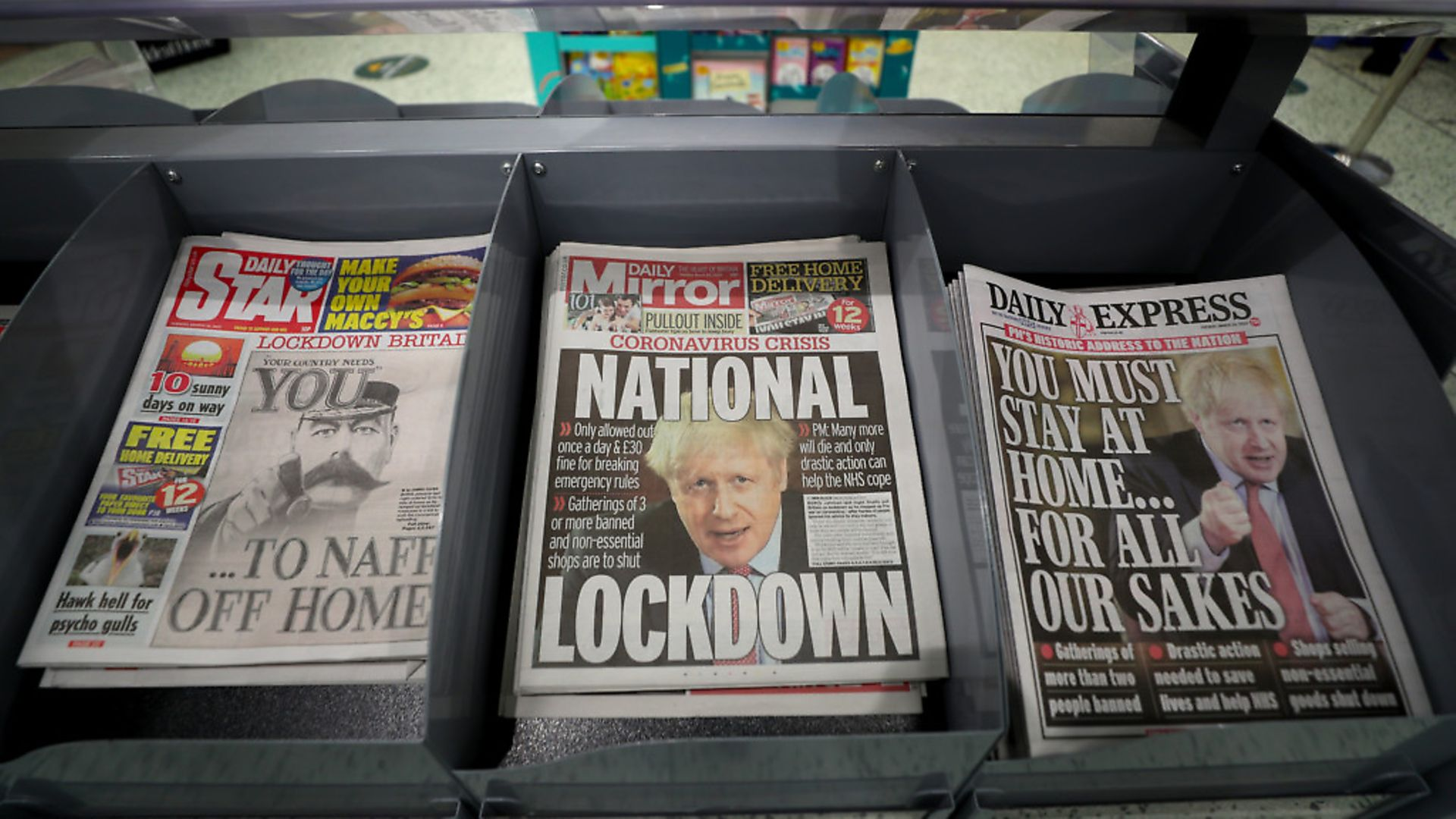 Newspapers displayed at a local shop the day after Boris Johnson put the UK in lockdown to help curb the spread of the coronavirus. Photograph: David Davies/PA. - Credit: PA