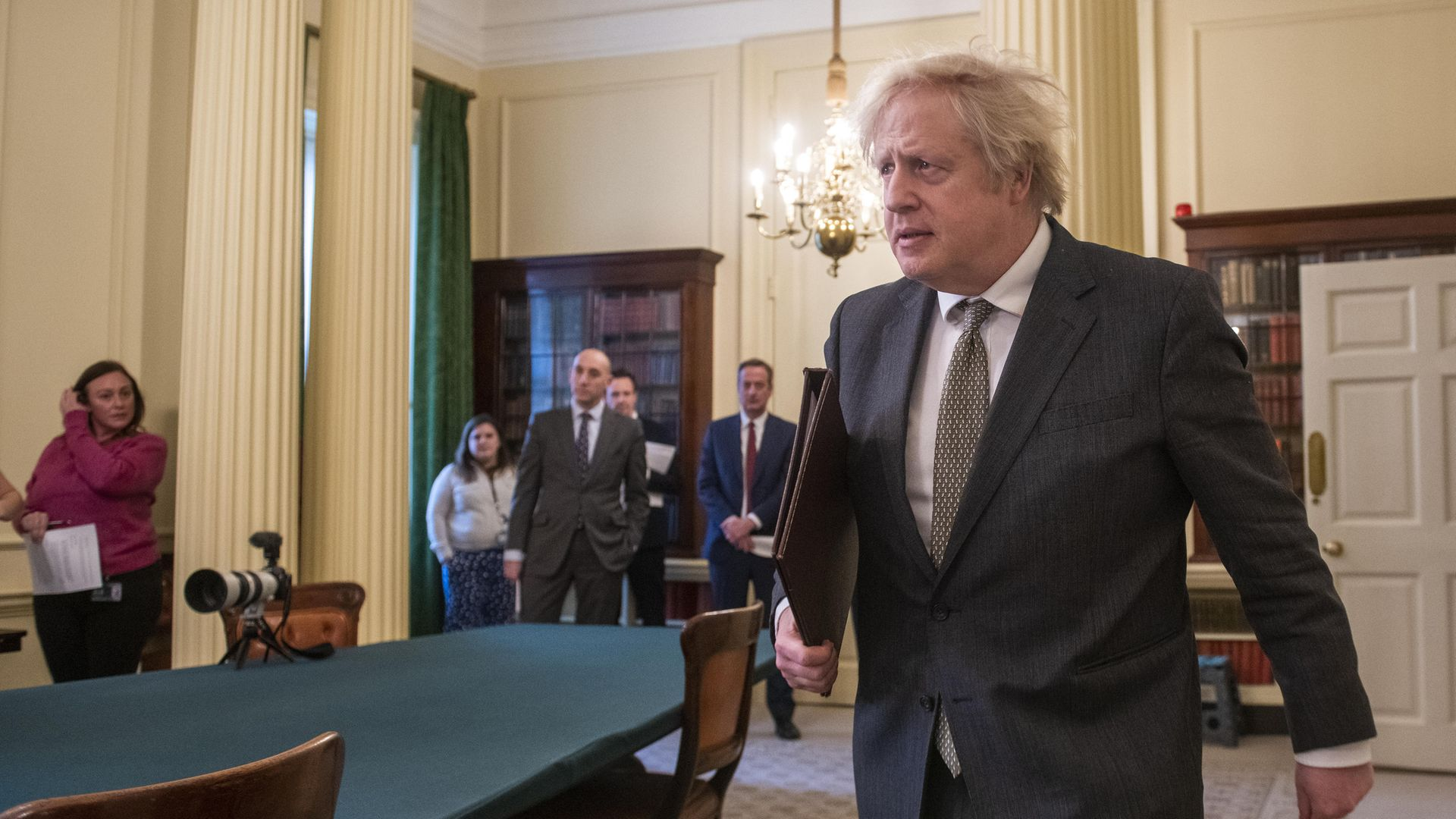 Prime Minister Boris Johnson arriving in the Cabinet Room - Credit: PA