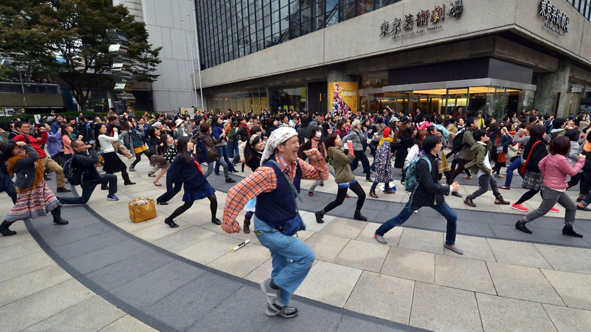 "People dance Yellow Magic Orchestra's (YMO) ""Rydeen"" in a flashmob event coreographed by Ryohei Kondo in Tokyo. (Photo YOSHIKAZU TSUNO/AFP via Getty Images) - Credit: AFP via Getty Images"