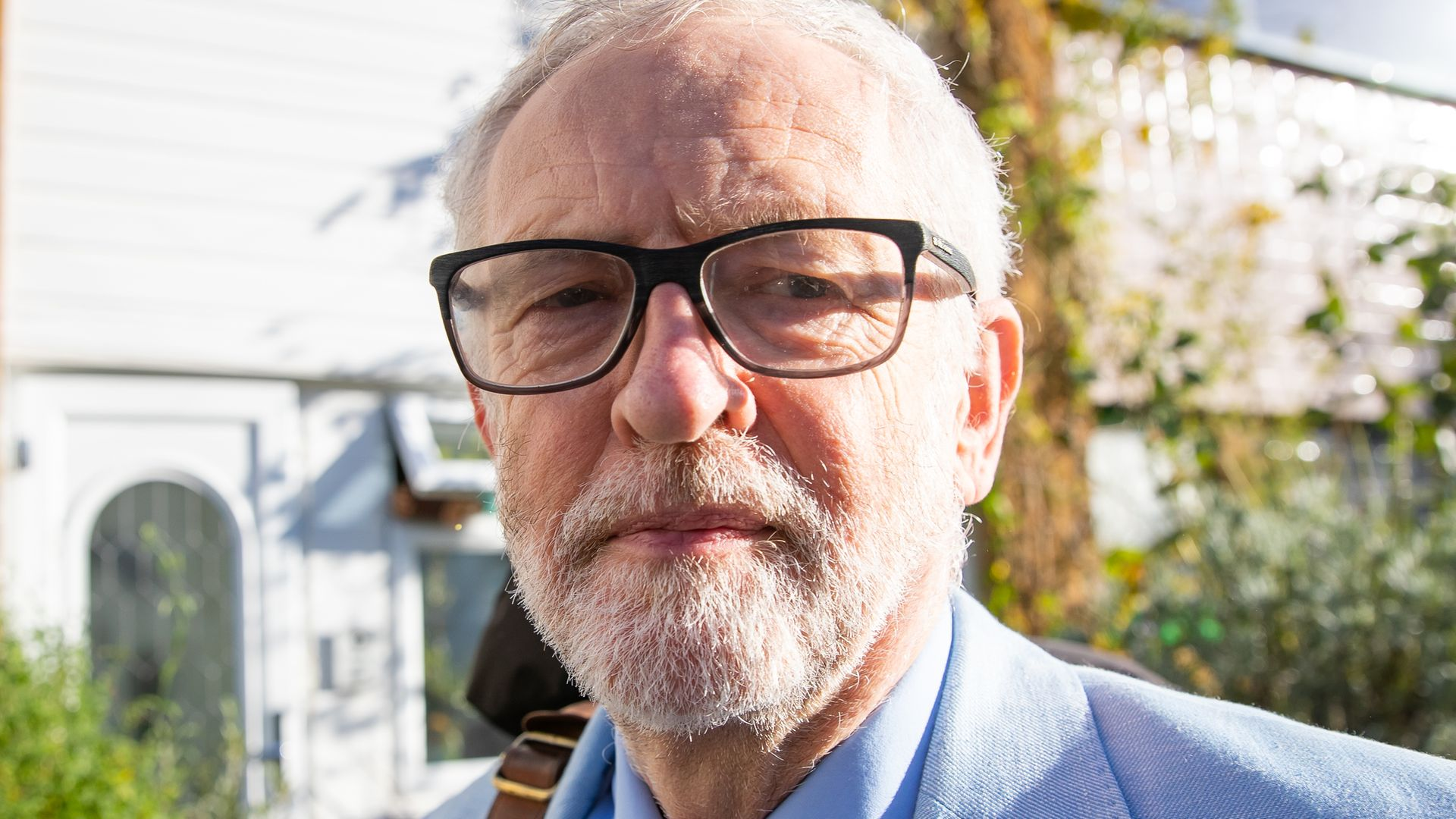 Former Labour leader Jeremy Corbyn (pictured above) has called on Boris Johnson to sack his health minister following his run-in with the law - Credit: PA