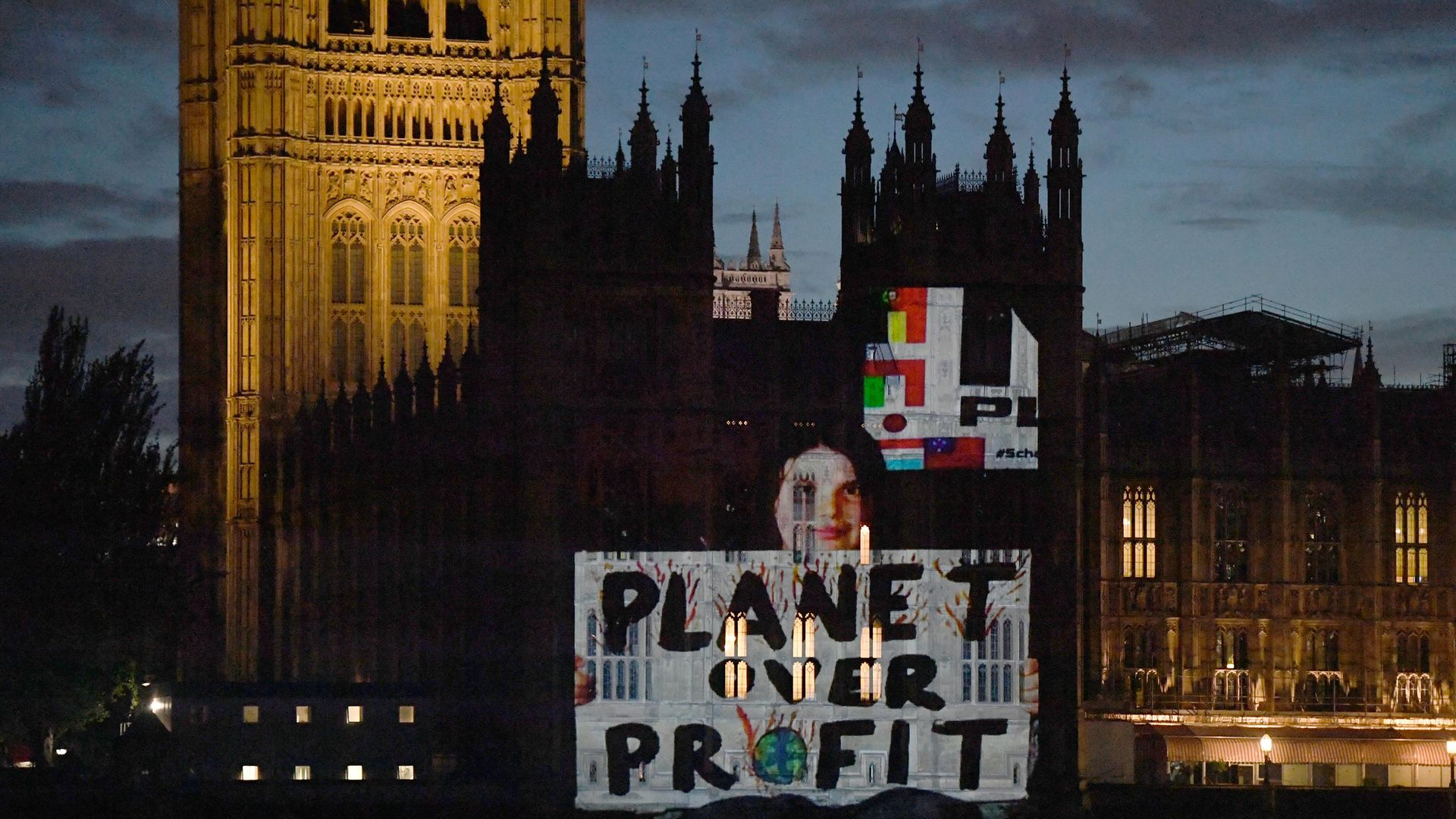 PLANET OVER PROFIT: London for School Strike for Climate Change project their message to Boris Johnson on to the Houses of Parliament - Credit: PA