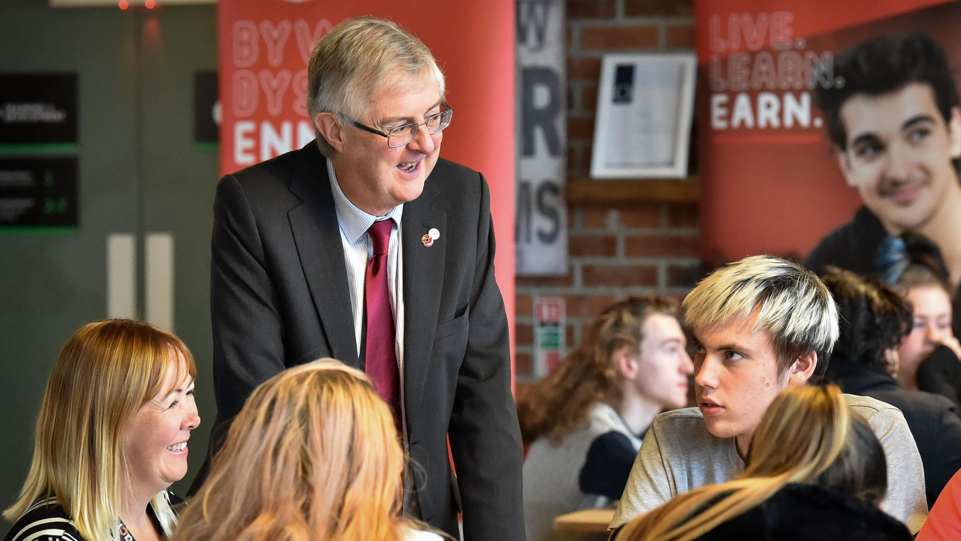 Wales' first minister Mark Drakeford chats with students at the ACT Training Centre - Credit: PA