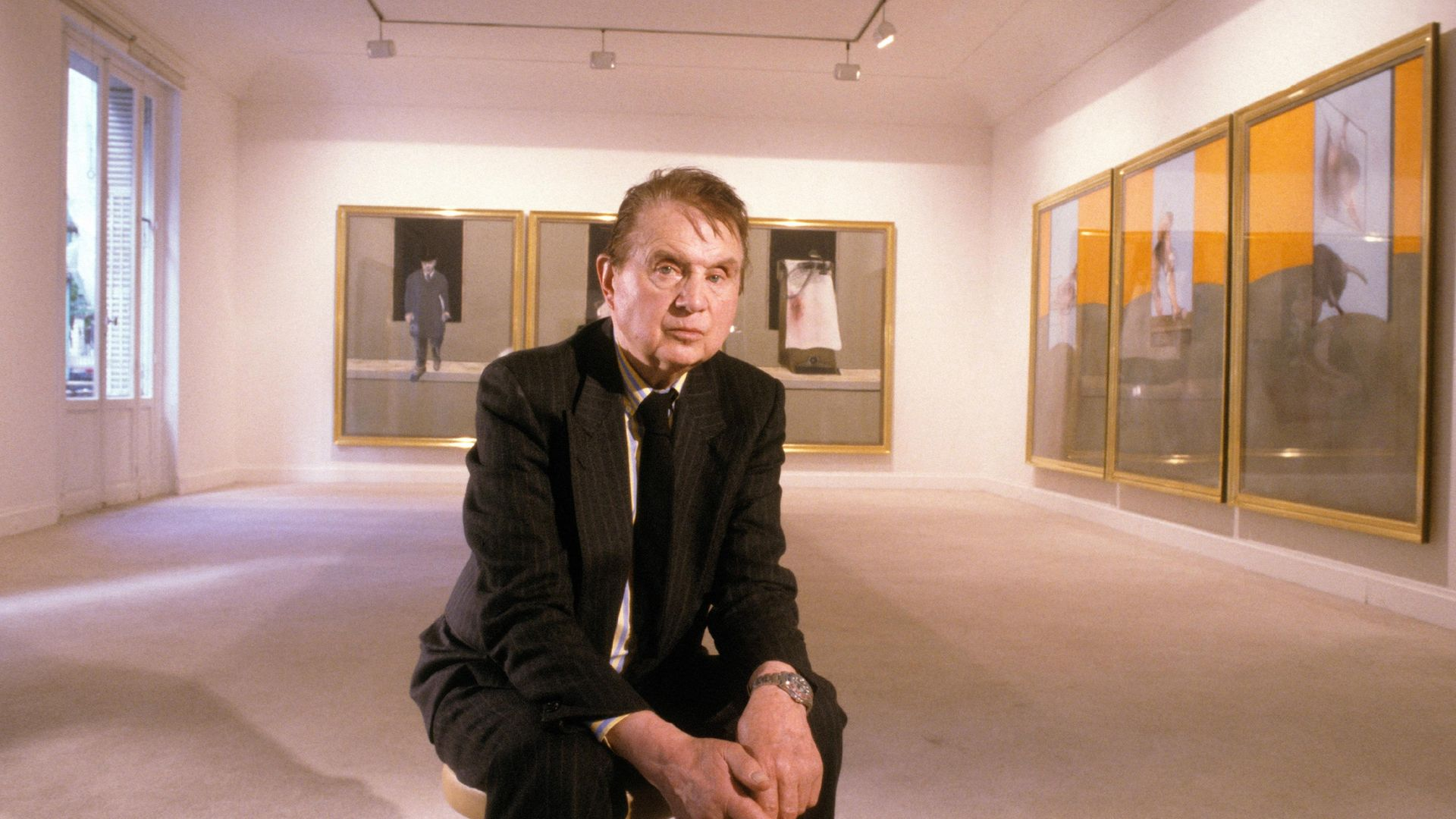 Painter Francis Bacon posing in front of paintings in a Paris gallery in 1987 - Credit: Gamma-Rapho via Getty Images