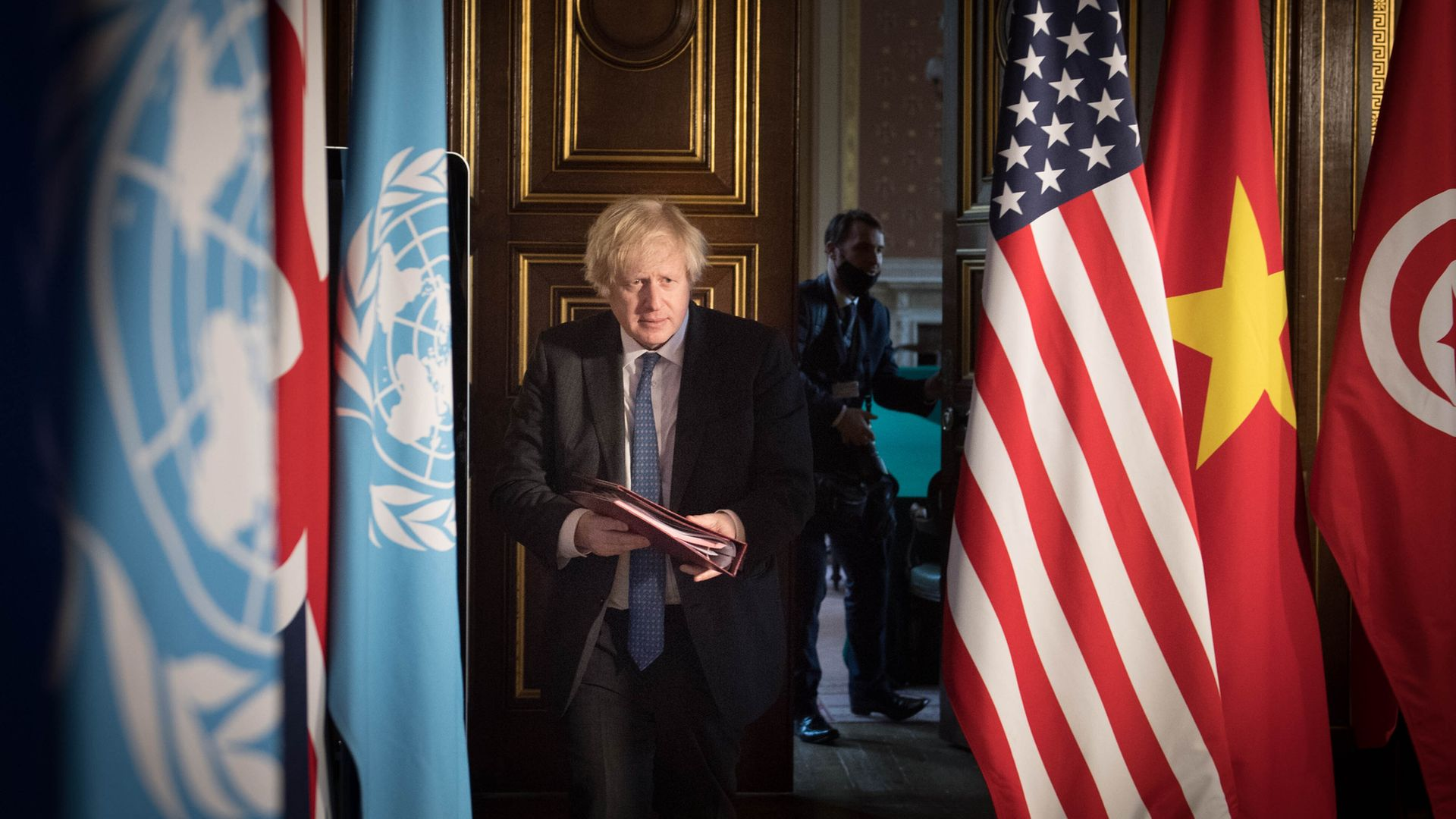 Prime minister Boris Johnson chairs a session of the UN Security Council on climate and security at the Foreign, Commonwealth and Development Office in London - Credit: PA