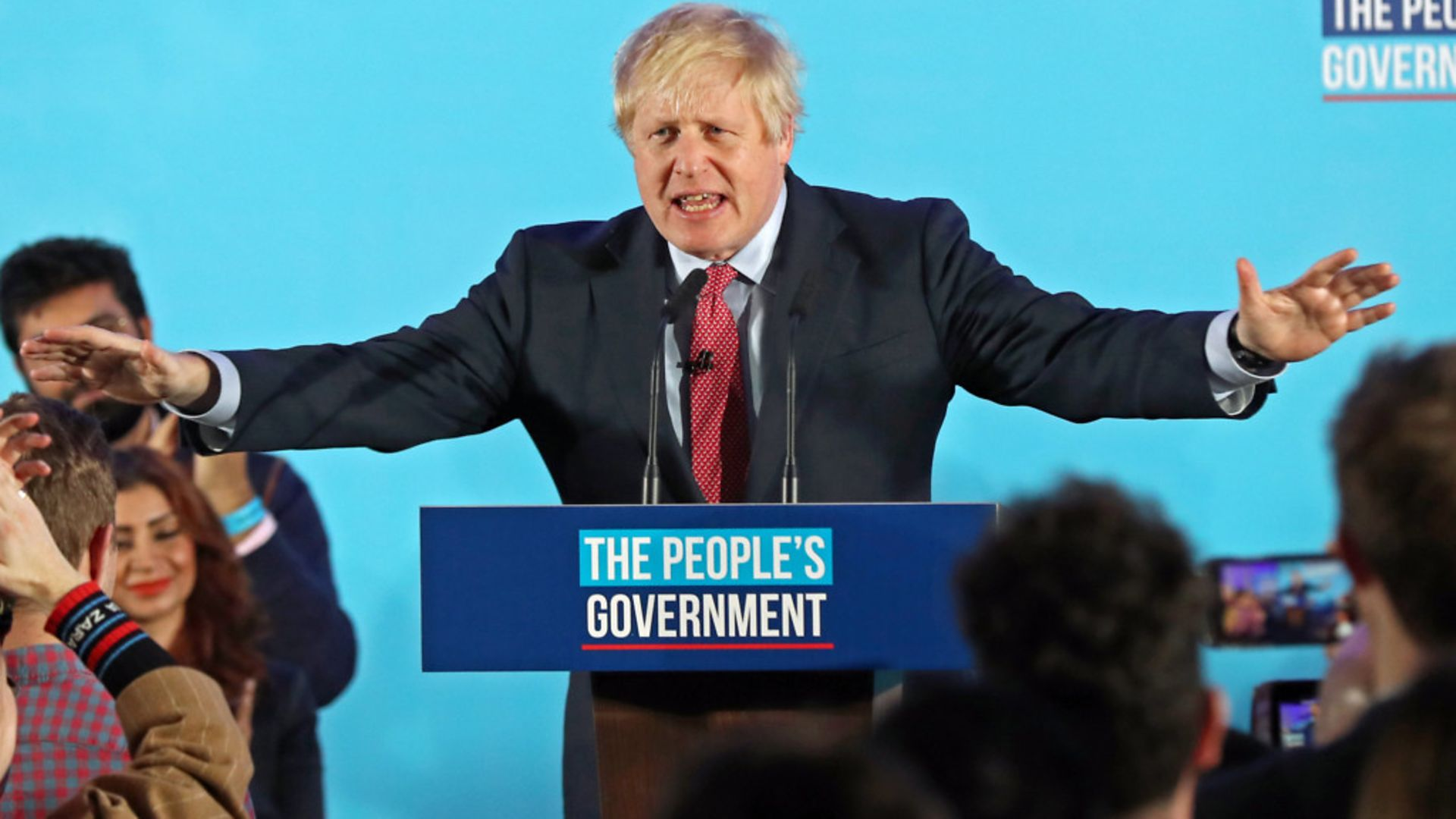 Boris Johnson at a rally with party supporters after the Conservative Party was returned to power in the General Election with an increased majority - Credit: PA