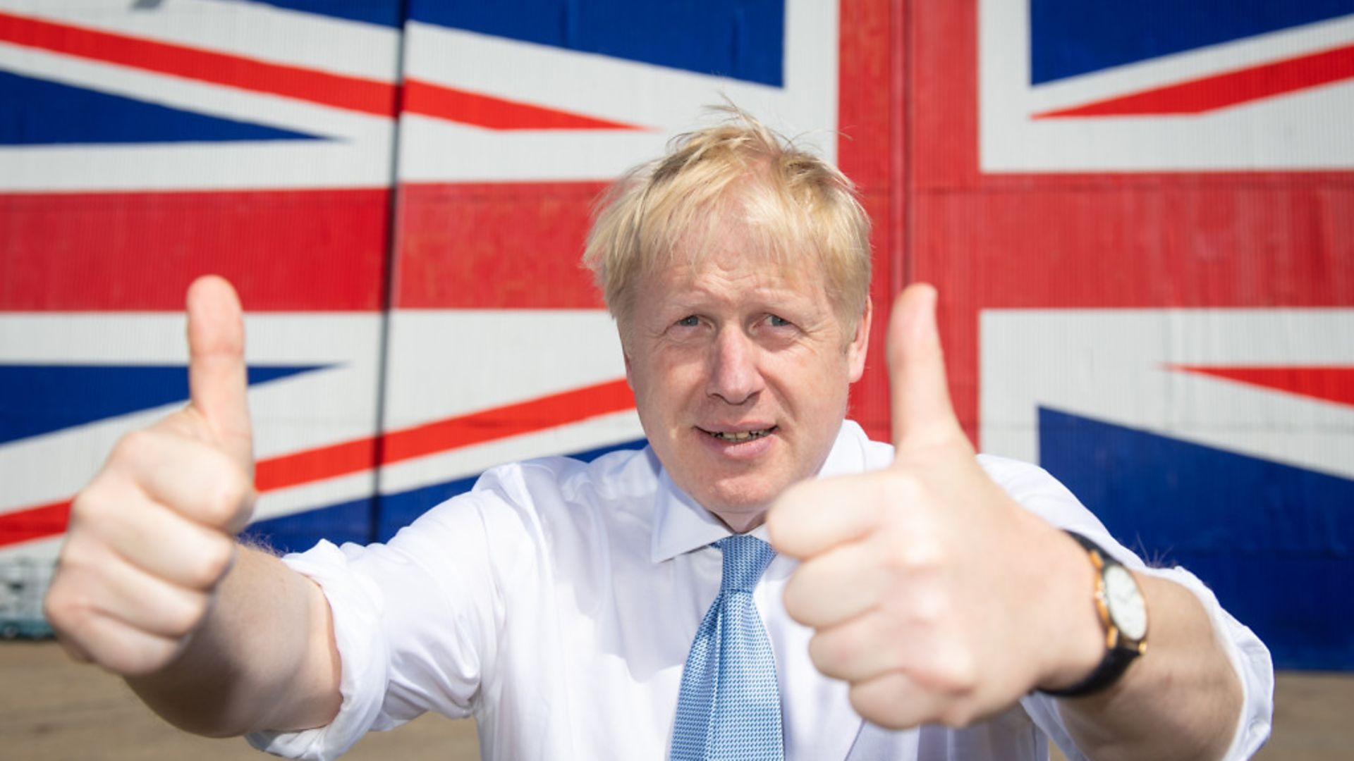 Boris Johnson poses for a 2019 photograph in front of a Union flag - Credit: Getty Images