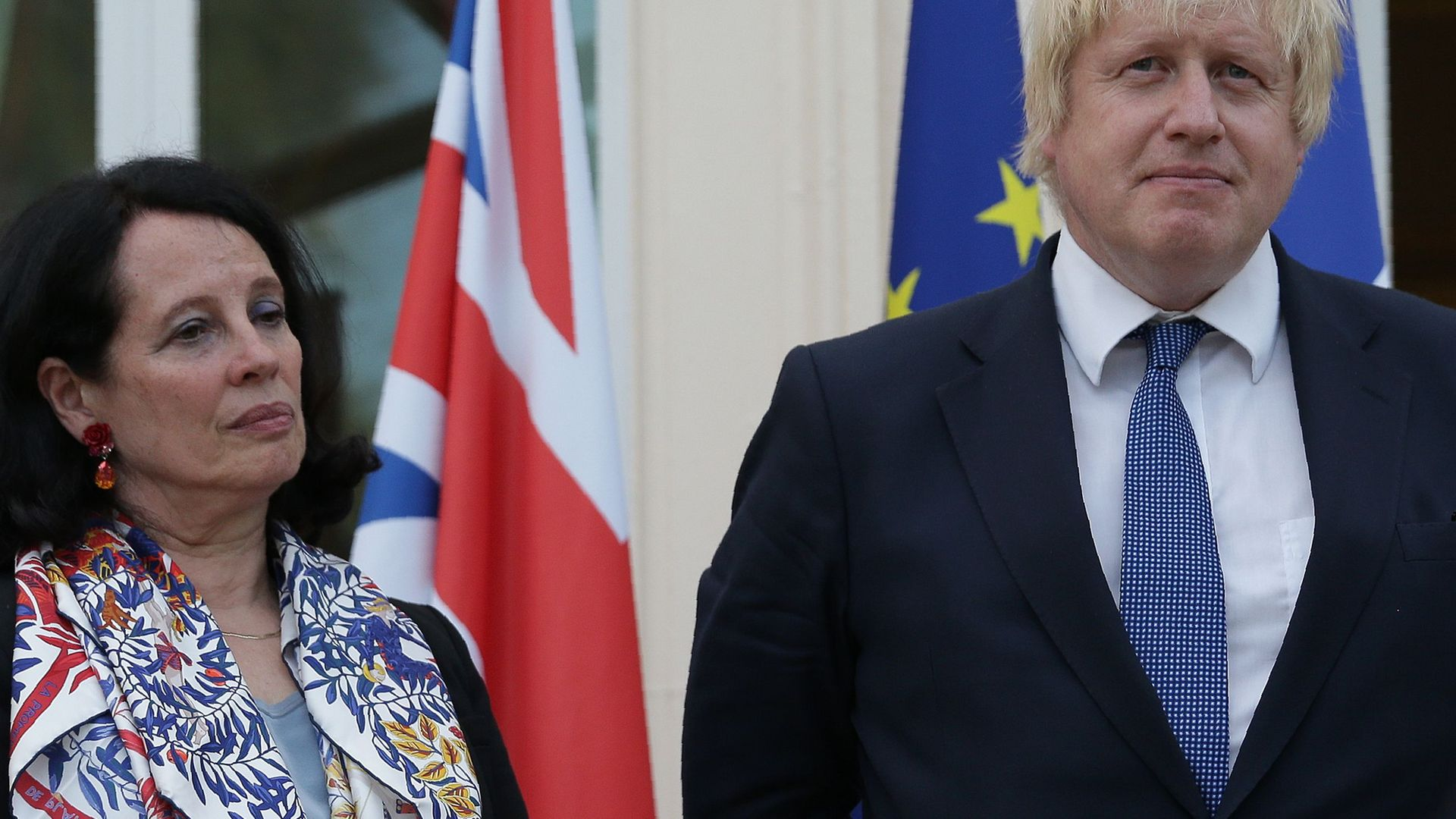 French ambassador Sylvie Bermann listens to Boris Johnson, then foreign secretary, speak during a reception in July 2016 - Credit: AFP via Getty Images