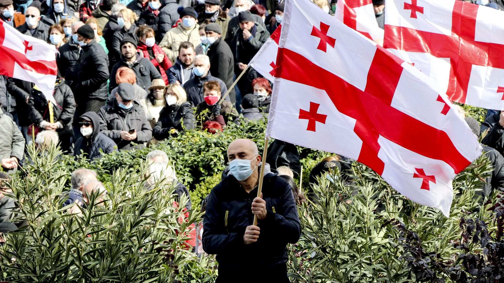 Supporters of United National Movement and the leaders of other opposition parties march to protest against detention of Nika Melia, the head of the main opposition United National Movement, in Tbilisi, Georgia - Credit: Anadolu Agency via Getty Images