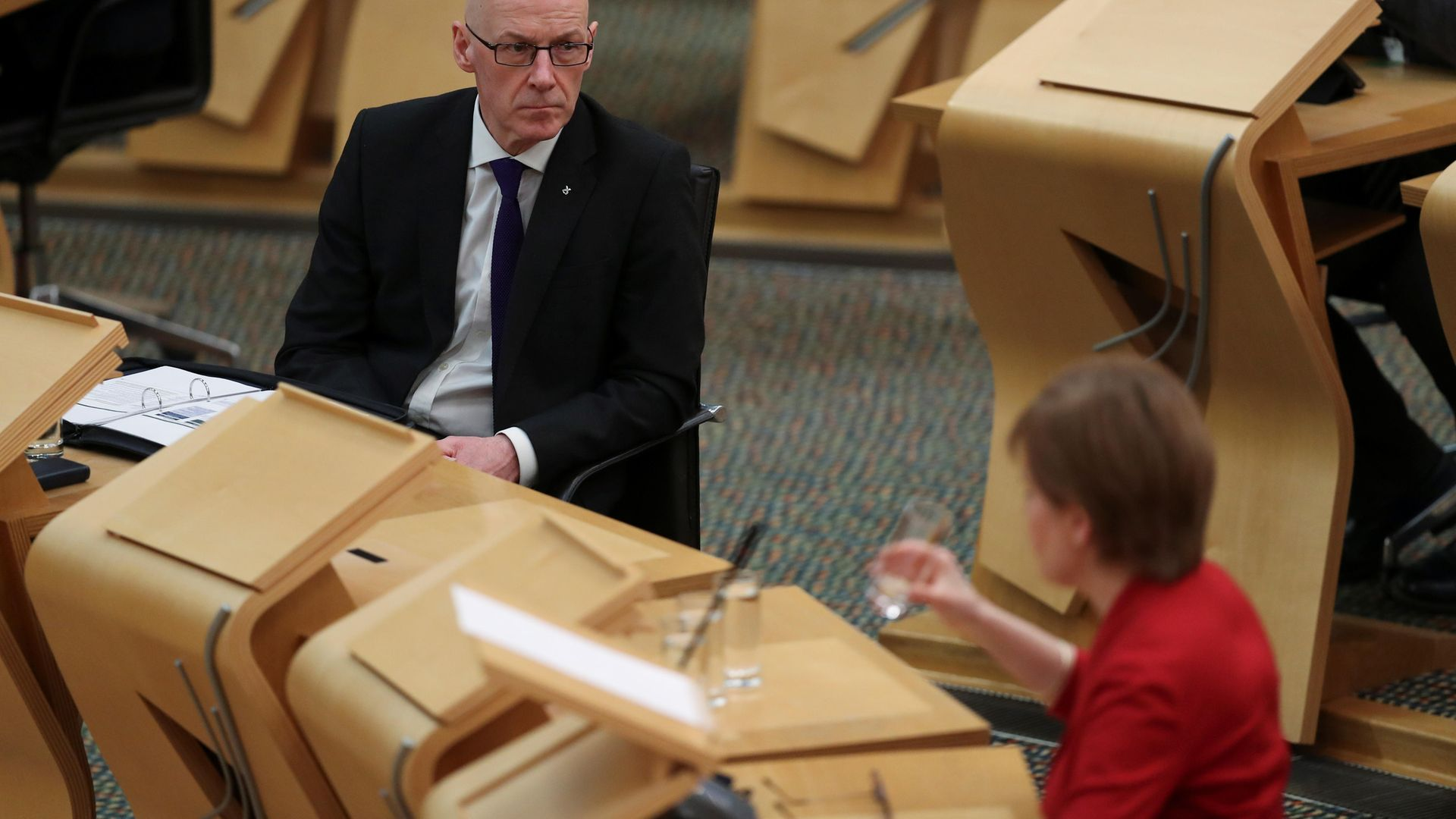 John Swinney (left) listens to First Minister Nicola Sturgeon as she makes a statement to the Scottish Parliament in Holyrood - Credit: PA