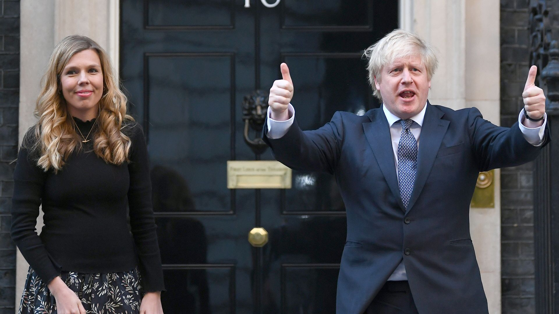 Prime minister Boris Johnson and his partner Carrie Symonds, stand in Downing Street, London - Credit: PA