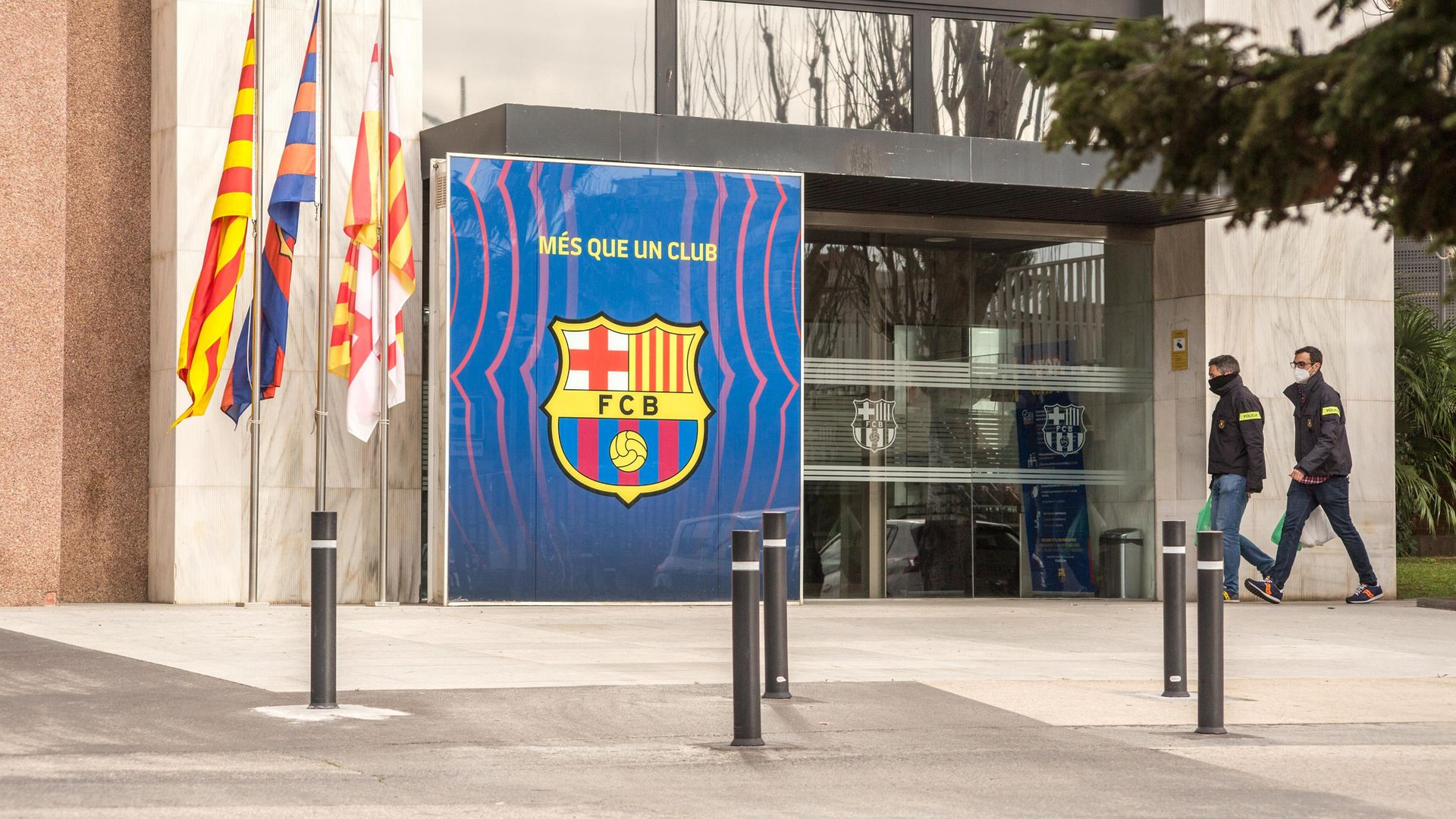Police officers are seen entering FC Barcelona's office on March 1, 2021 as part of an ongoing investigation into alleged corruption that led to the arrest of former club president Josep Maria Bartomeu - Credit: SOPA Images/LightRocket via Gett