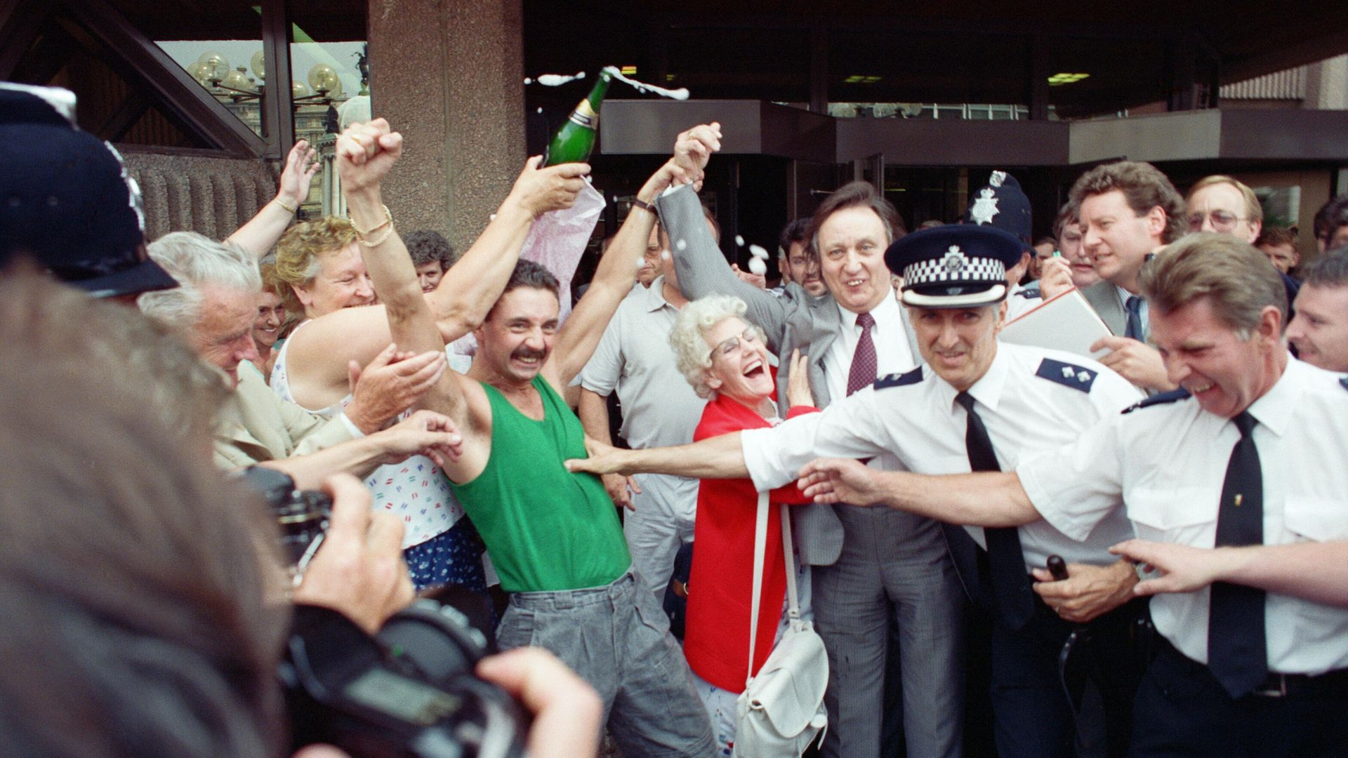 Comedian Ken Dodd celebrates with supporters after being acquitted of tax evasion charges at Liverpool Crown Court - Credit: Getty Images