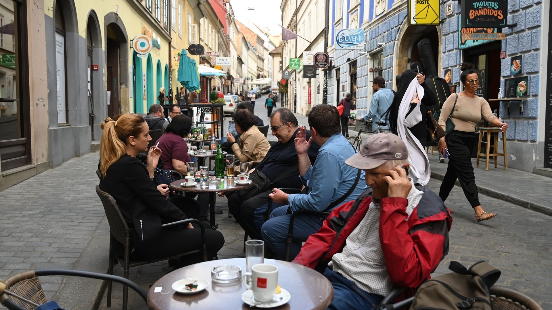 CAFE CULTURE: Customers on the terrace of a cafe in Zagreb, in May 2020. Such establishments offer a popular venue for political discussion and debate across central and southern Europe - Credit: AFP via Getty Images
