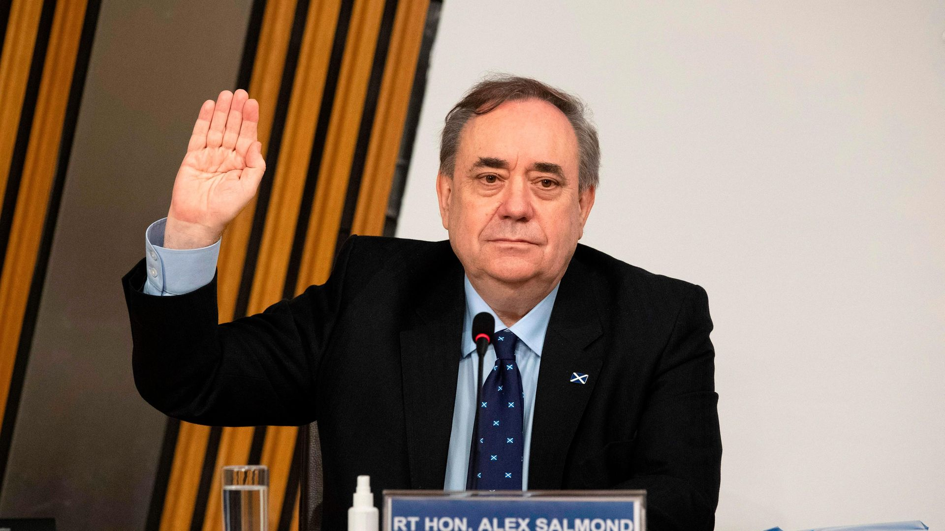 Former SNP leader and former first minister of Scotland Alex Salmond is sworn in before giving his evidence to the Holyrood committee investigating the handling of harassment allegations against him - Credit: POOL/AFP via Getty Images