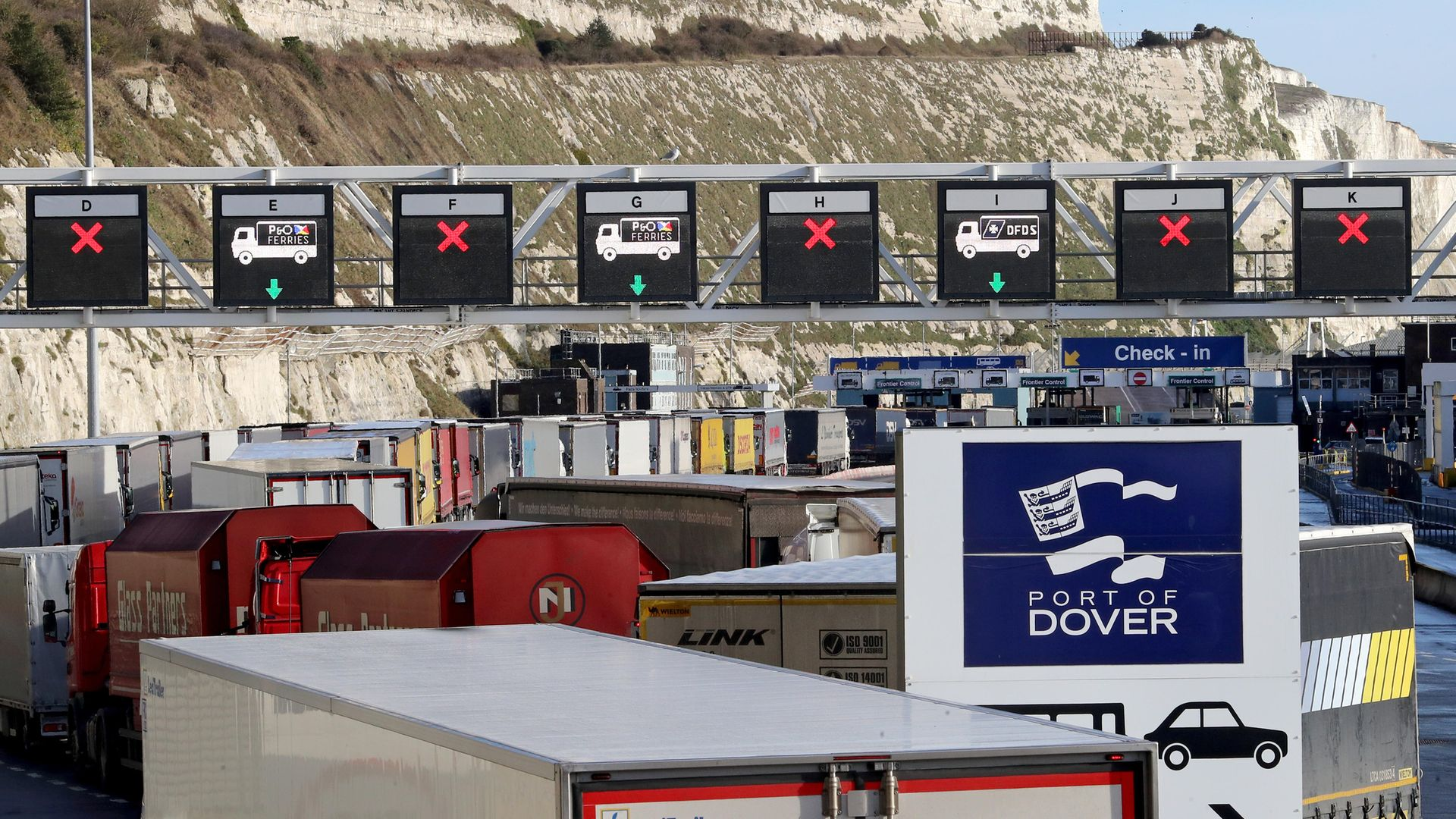 Lorries queue for the frontier control area at the Port of Dover in Kent - Credit: PA