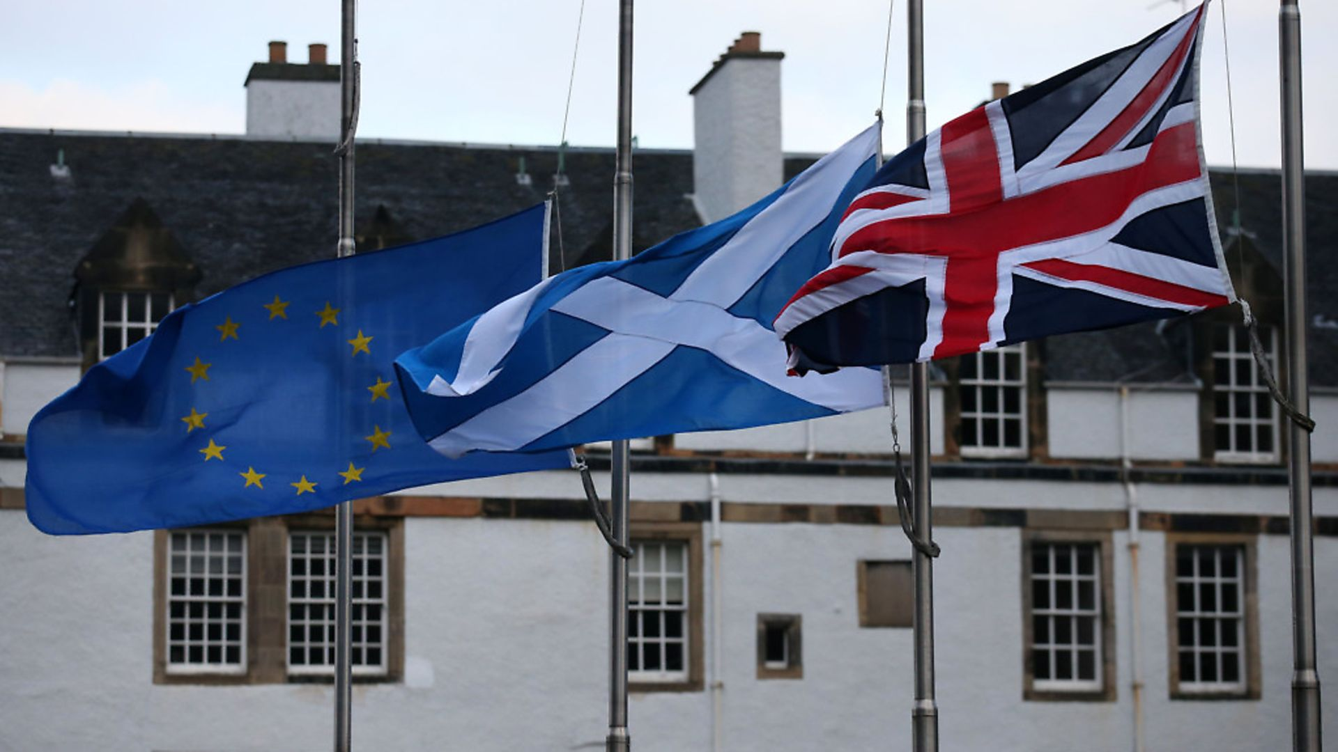 An European Union, a Saltire and an Union flag fly outside the Scottish Parliament in Edinburgh - Credit: PA Archive/PA Images