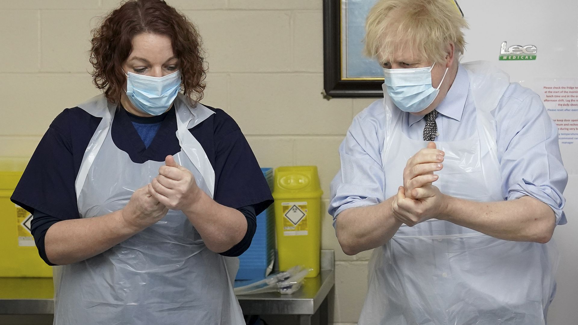 Prime Minister Boris Johnson is shown how to prepare the vaccine by advance nurse practitioner Sarah Sowden during a visit to a coronavirus vaccination centre in Batley, West Yorkshire. Picture date: Monday February 1, 2021. - Credit: PA