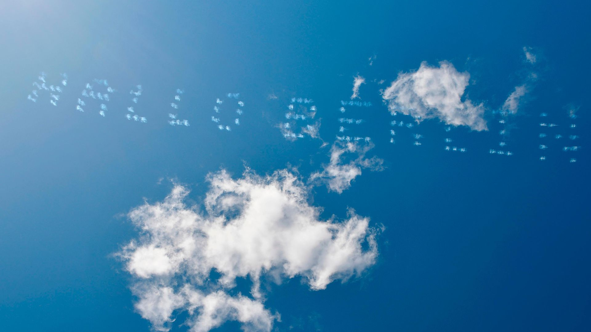 Aeroplanes write Hello Berlin in the sky in Berlin's former Tempelhof airport on March 5, 2021 - Credit: AFP via Getty Images
