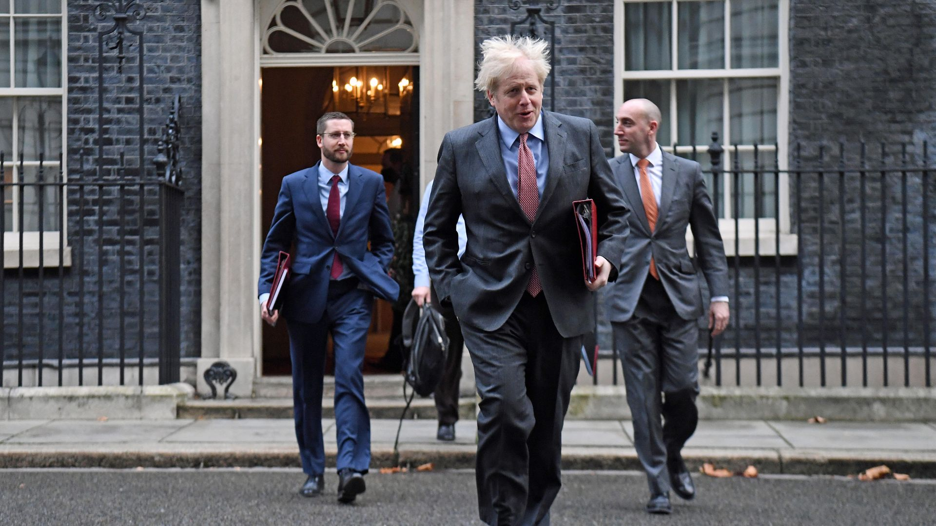 Prime Minister Boris Johnson leads colleagues including Cabinet Secretary Simon Case (left), across Downing Street as they arrive for the government's weekly Cabinet meeting at the Foreign and Commonwealth Office (FCO). - Credit: PA