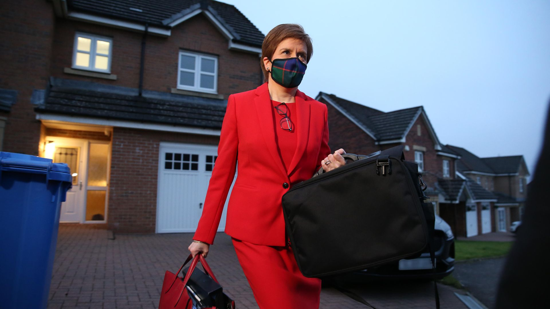 First minister of Scotland, Nicola Sturgeon, leaves her home in Glasgow to head to Holyrood in Edinburgh to give evidence to the Scottish parliament's inquiry into her government's unlawful investigation of the former first minister Alex Salmond - Credit: PA