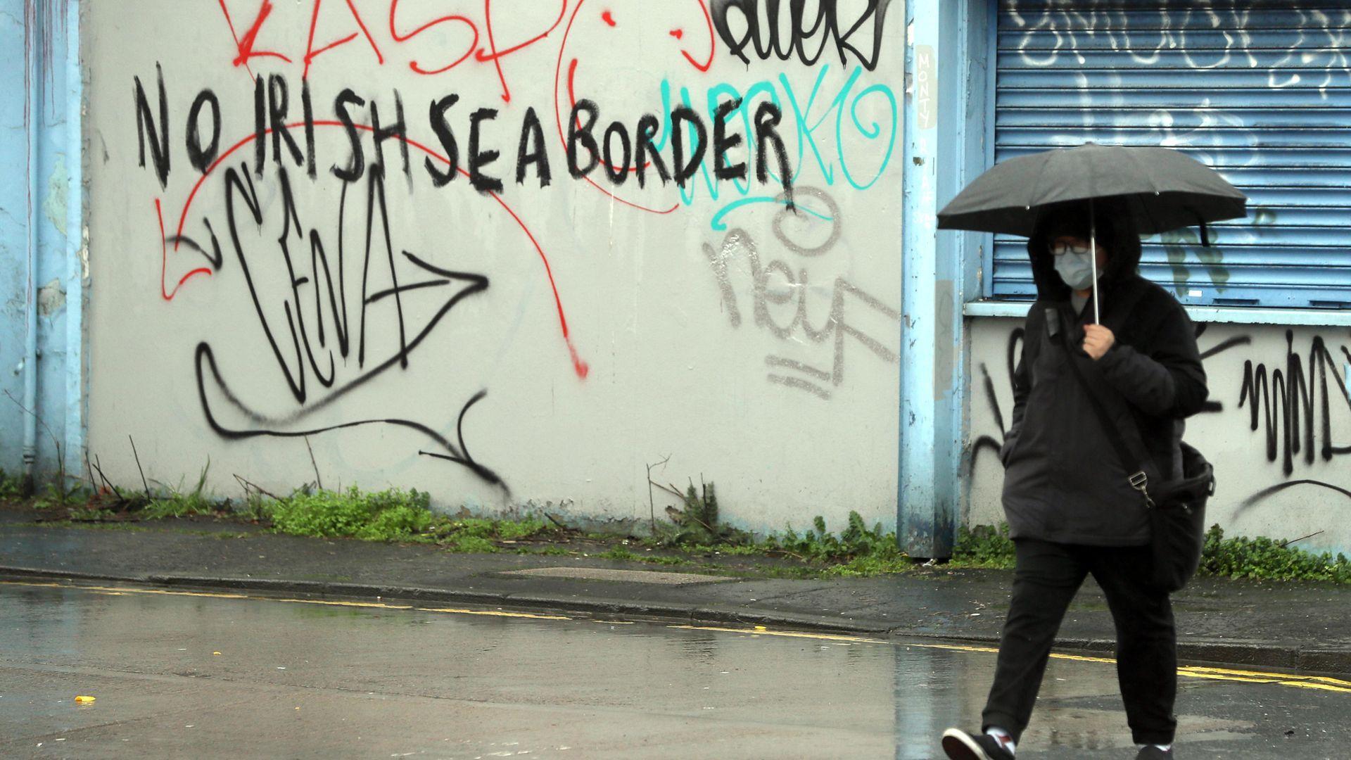 Graffiti reading 'No Irish Sea border' Stroud Street in Belfast - Credit: PA