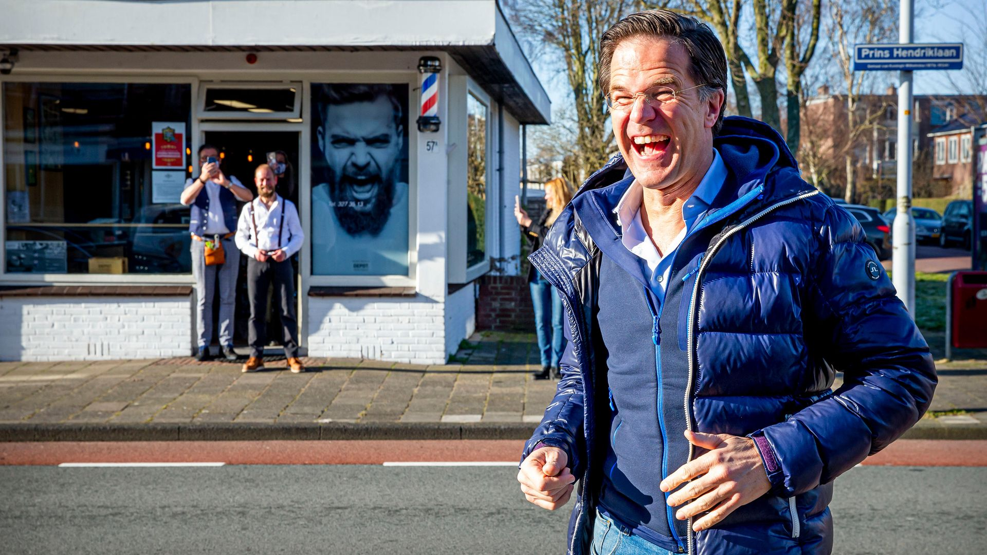 A buoyant Mark Rutte visits his hairdresser in Leidschendam after lockdown, during campaigning for the elections - Credit: Getty Images