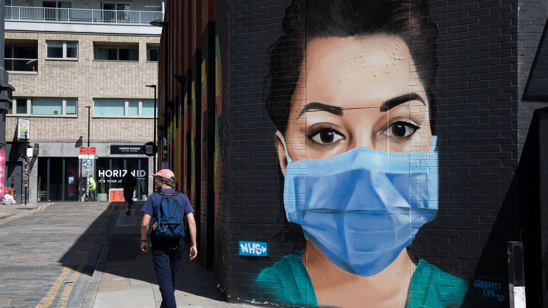 A mural of an NHS nurse wearing a face mask in east London - Credit: In Pictures via Getty Images