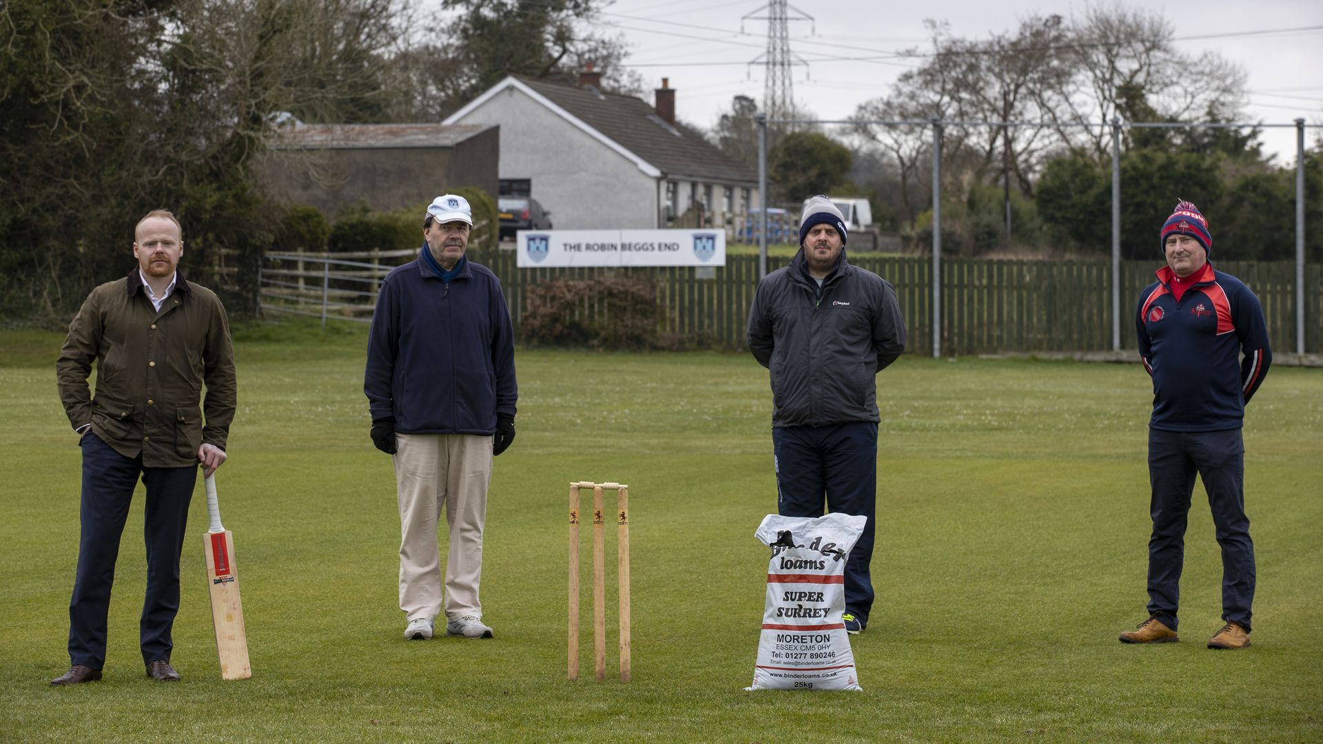 (left to right) UUP MLA John Stewart, President of the Northern Cricket Union (NCU) Roger Bell, NCU Grounds Committee Member Michael Kennedy and NCU Cricket Operations Manager Uel Graham on the crease of Carrickfergus Cricket Club. The special cricket pitch soil used for generations may have to be dug up and replaced due to the Northern Ireland Protocol, according to a groundsman. - Credit: PA