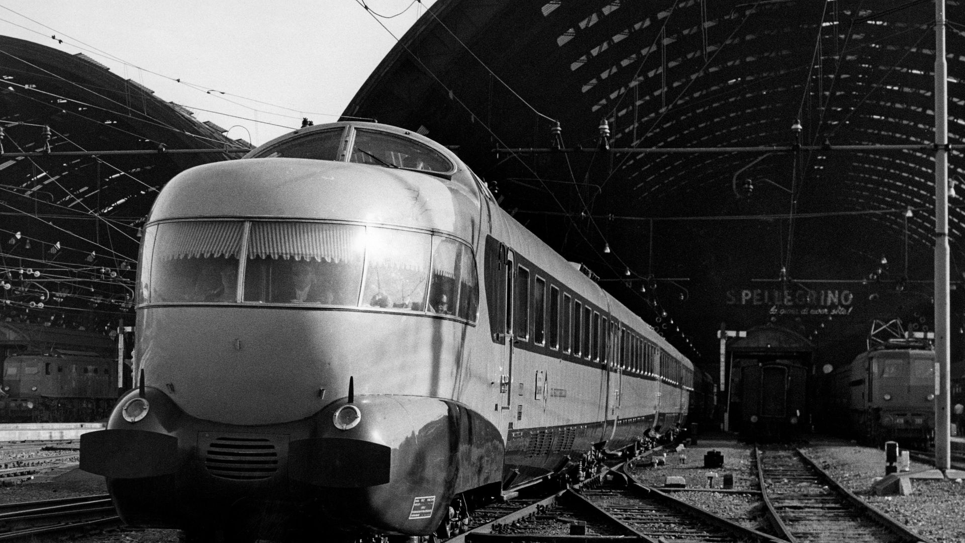 One of Italy's distinctive Settebello services – complete with observation lounge and the front – pulls out of Milan's Central Station - Credit: Touring Club Italiano/Marka/Univ