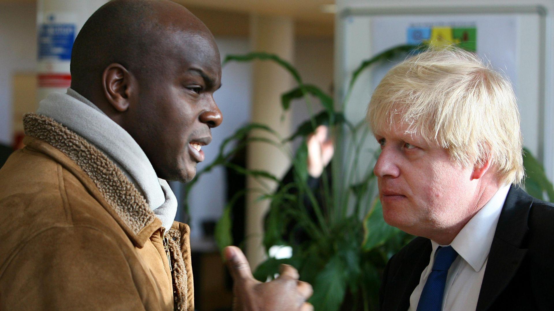 Boris Johnson talks to Shaun Bailey (left) - Credit: PA